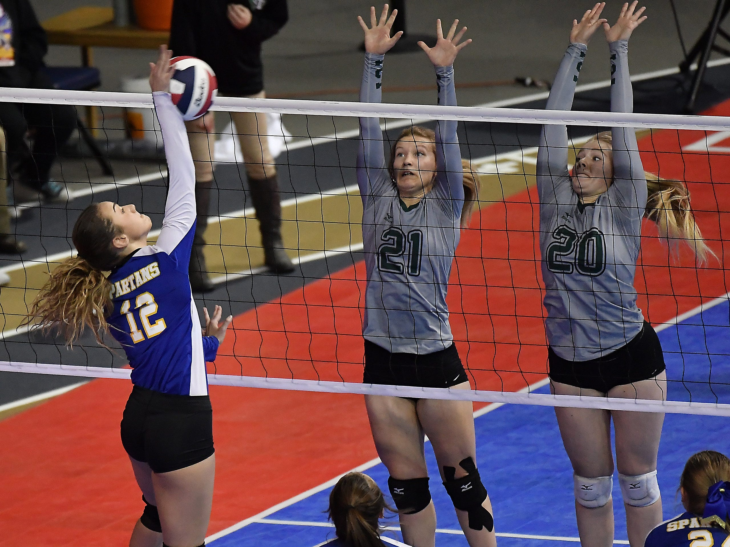Kylee Cook of Scobey attacks as Tri-Cities' Sami Connerton (21) and Sierra Stahl (20) defend during a Class C match at the All-Class State Volleyball Tournament at the Brick Breeden Fieldhouse in Bozeman Friday.