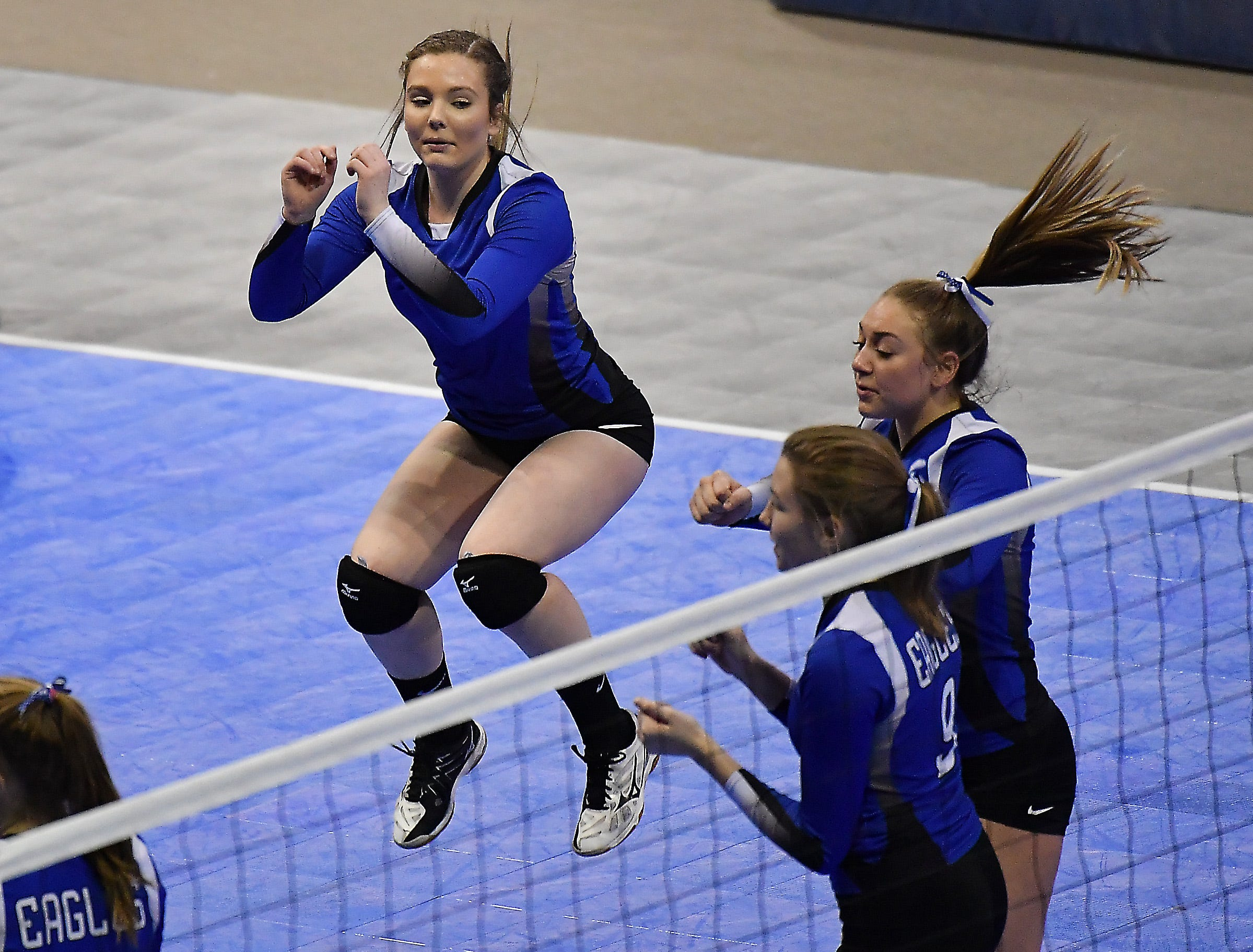 Fairfield's Cheyenne Maddox leaps in celebration in a match against Deer Lodge at the All-Class State Volleyball Tournament at the Brick Breeden Fieldhouse in Bozeman.