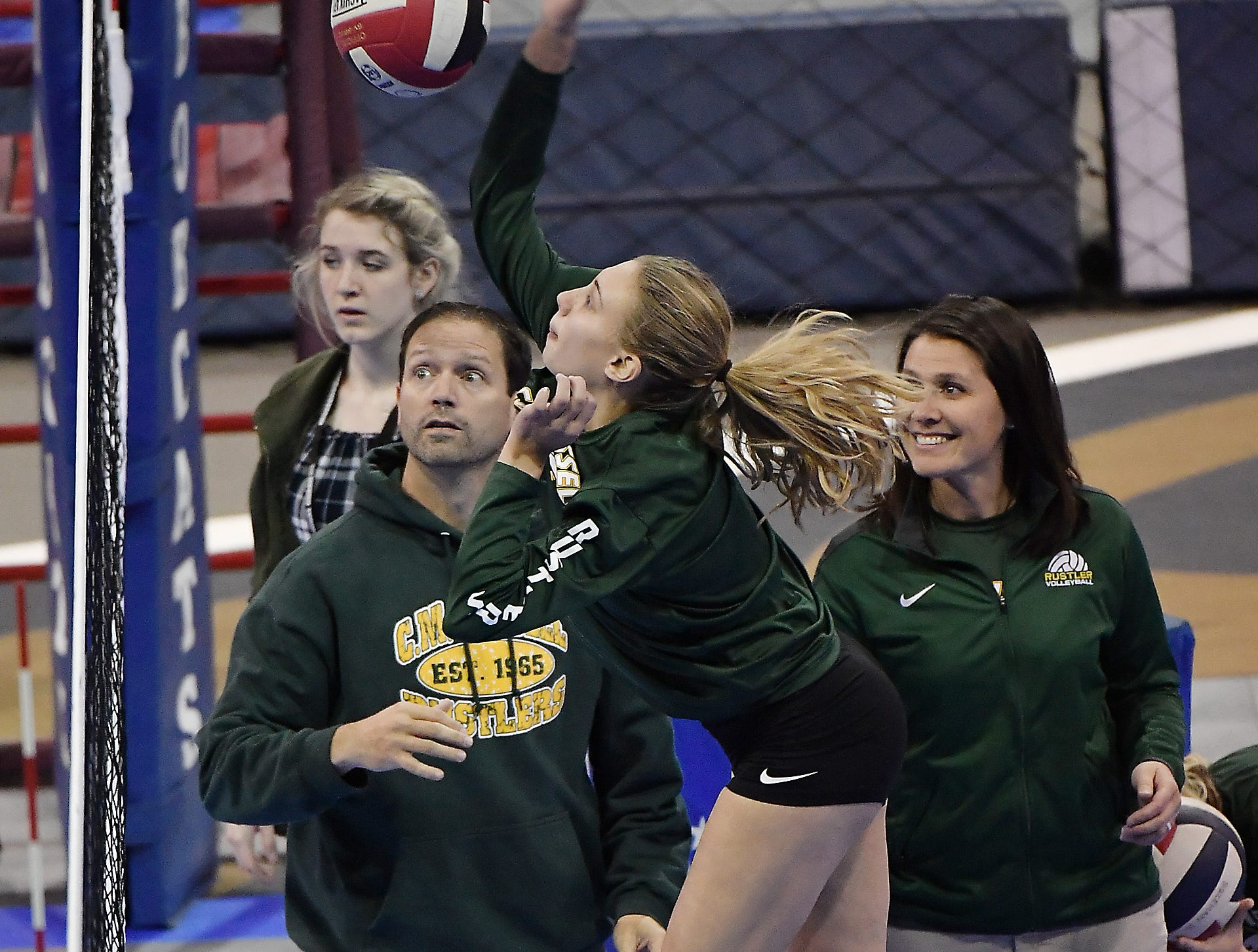 CMR head coach Patrick Hiller, left, and assistant Kelly Lindseth look on during warm-ups of a match against Kalispell Flathead at the All-Class State Volleyball Tournament at the Brick Breeden Fieldhouse in Bozeman Friday.