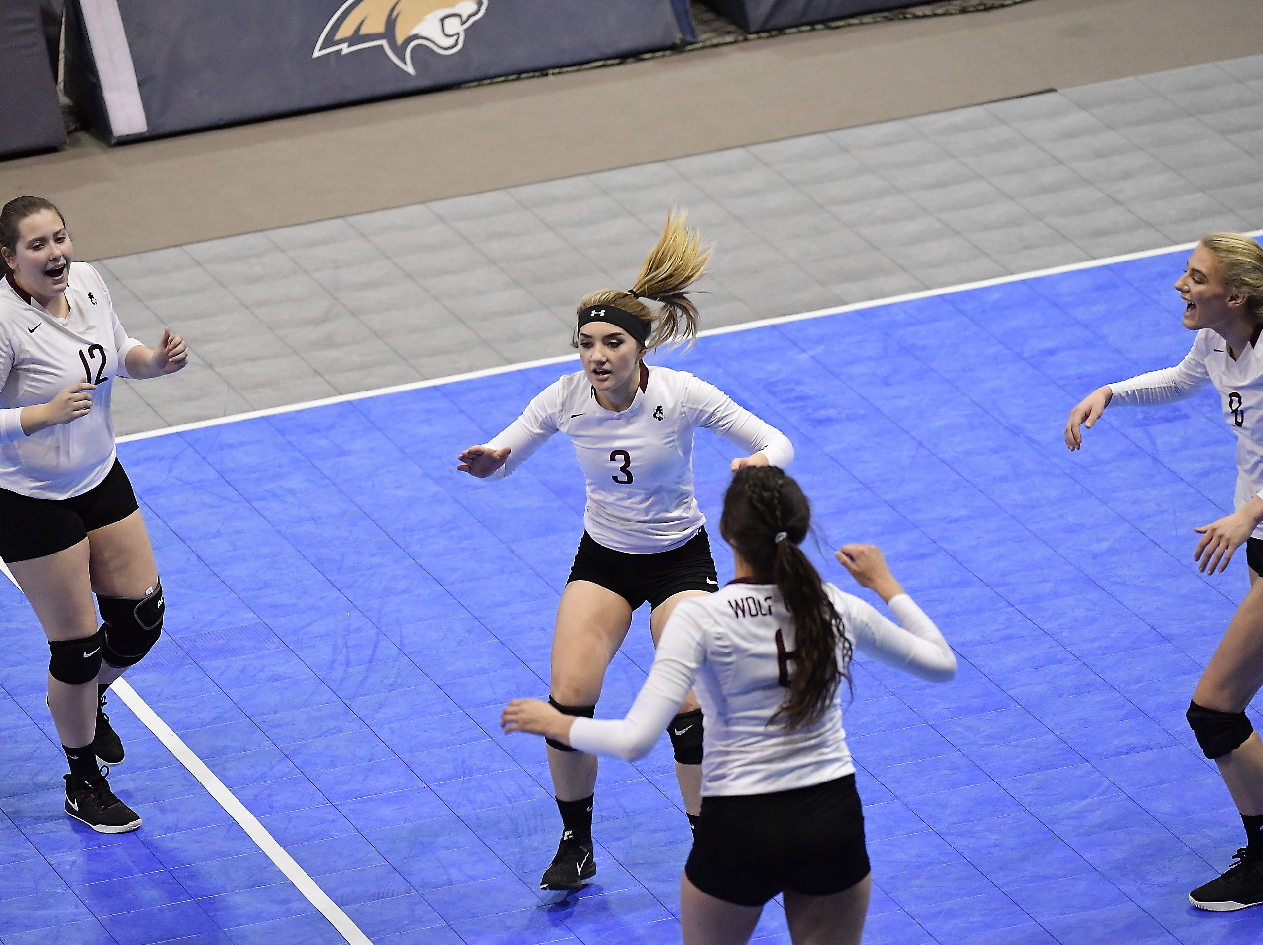 Wolf Point celebrates during a match with Deer Lodge at the All-Class State Volleyball Tournament at the Brick Breeden Fieldhouse in Bozeman Friday.
