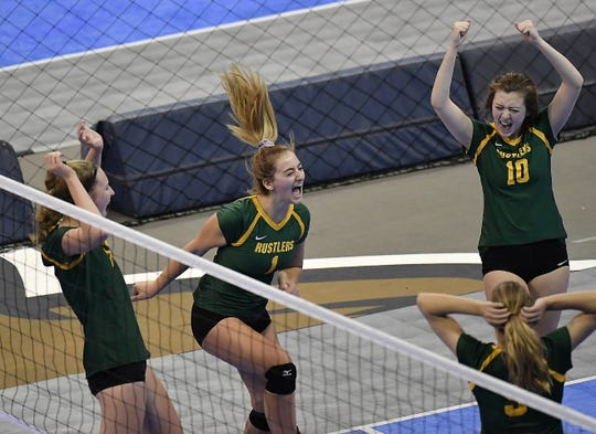 CMR celebrates a point against Kalispell Flathead at the All-Class State Volleyball Tournament at the Brick Breeden Fieldhouse in Bozeman Friday.