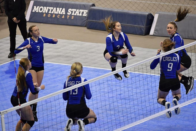 The Fairfield Eagles celebrate a point against Deer Lodge at the All-Class State Volleyball Tournament at the Brick Breeden Fieldhouse in Bozeman.