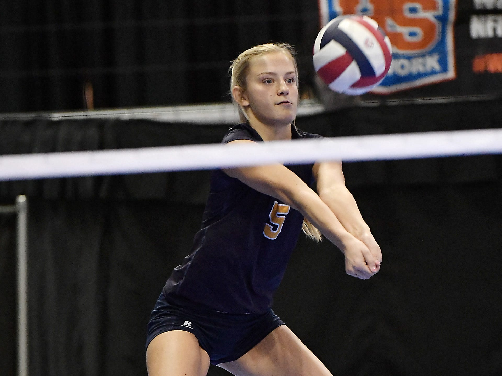 Josee Applegate of Deer Lodge eyes the ball in a match with Wolf Point at the All-Class State Volleyball Tournament at the Brick Breeden Fieldhouse in Bozeman Friday.
