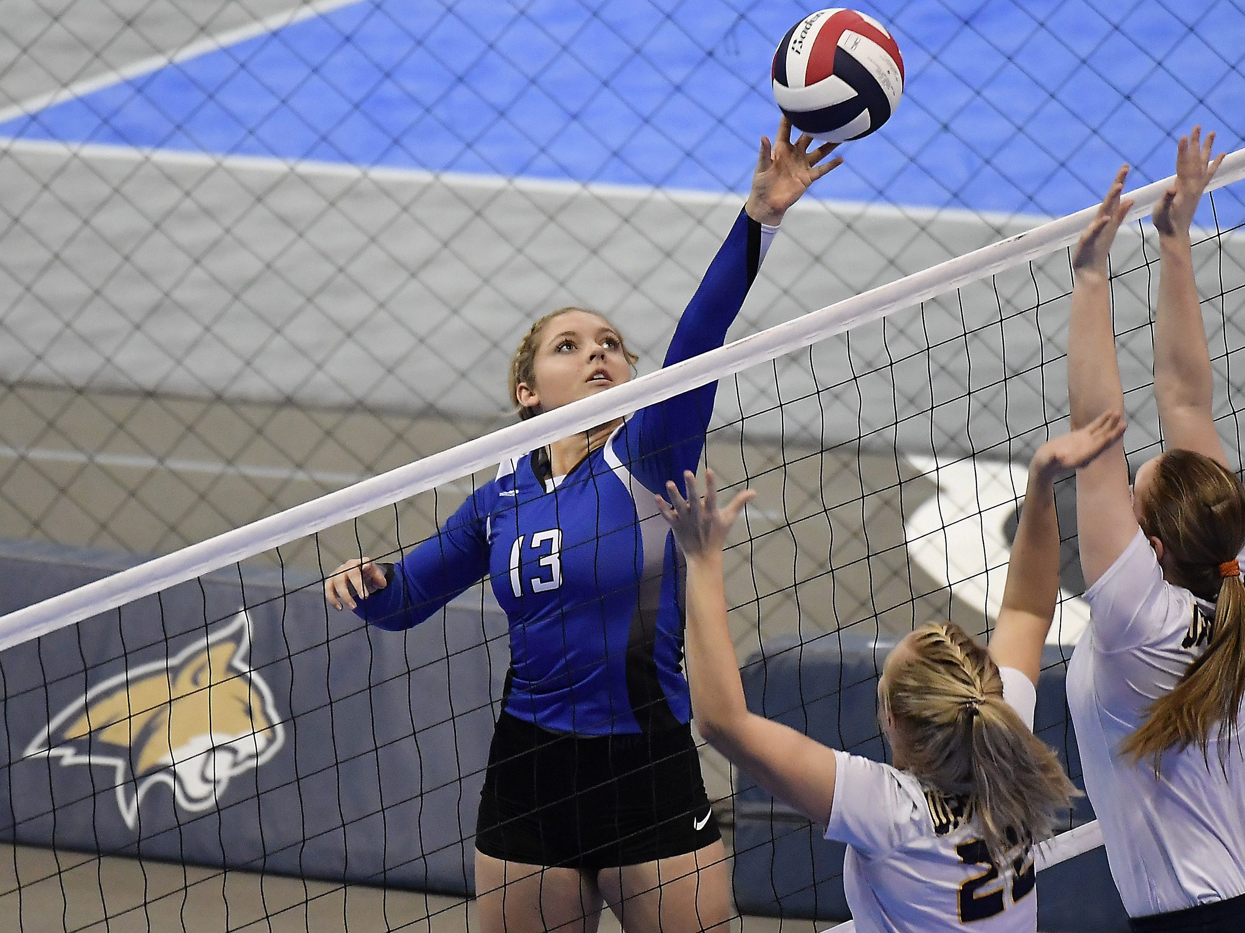 Fairfield's Taylor Simmons tips the ball against Deer Lodge at the All-Class State Volleyball Tournament at the Brick Breeden Fieldhouse in Bozeman.