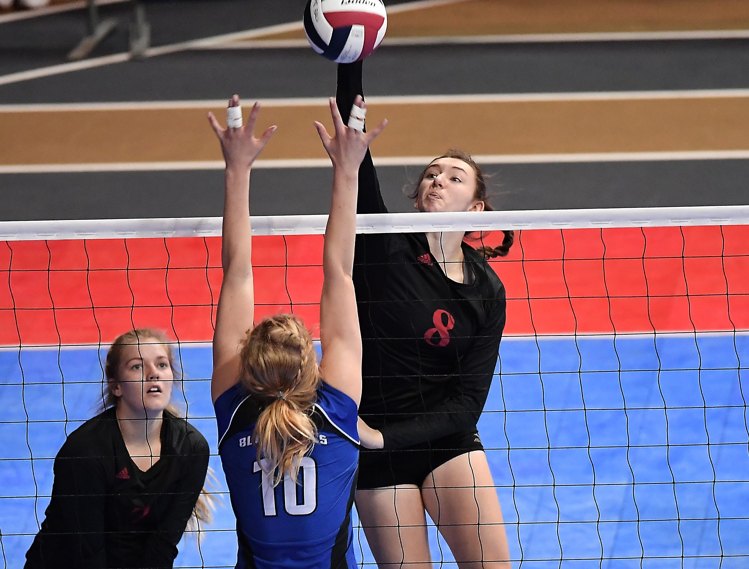 Karsen Murphy of Glendive gets the kill against Corvallis at the All-Class State Volleyball Tournament at the Brick Breeden Fieldhouse in Bozeman.