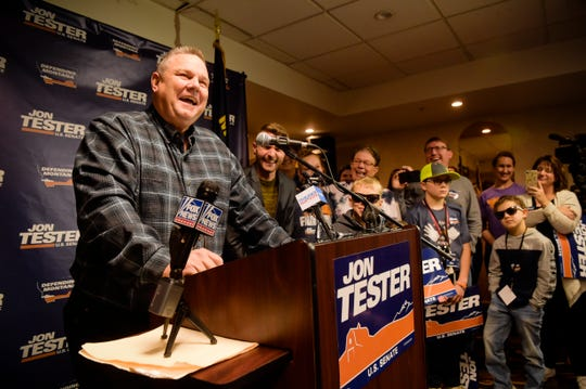 Sen. Jon Tester surrounded by family and supporters, announces his victory Nov. 7 in Great Falls. He won a third term over Republican Matt Rosendale.