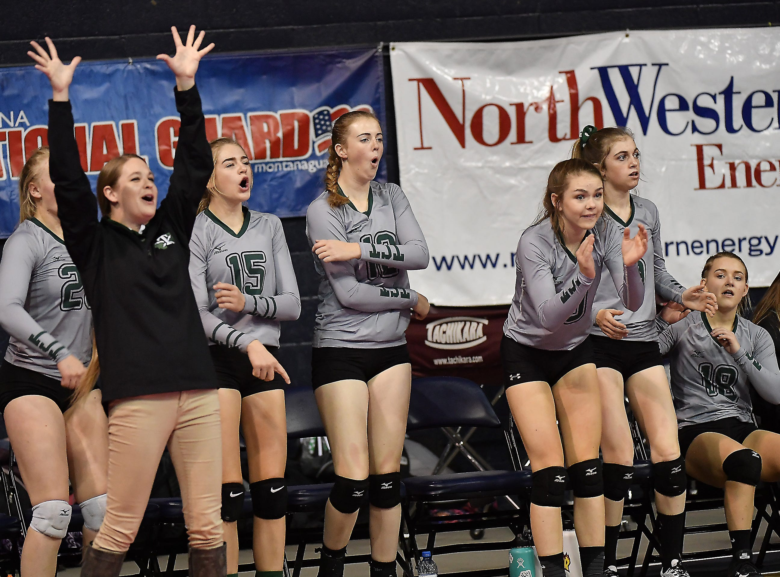 The Tri-Cities' bench cheers during a match with Scobey at the All-Class State Volleyball Tournament at the Brick Breeden Fieldhouse in Bozeman Friday.