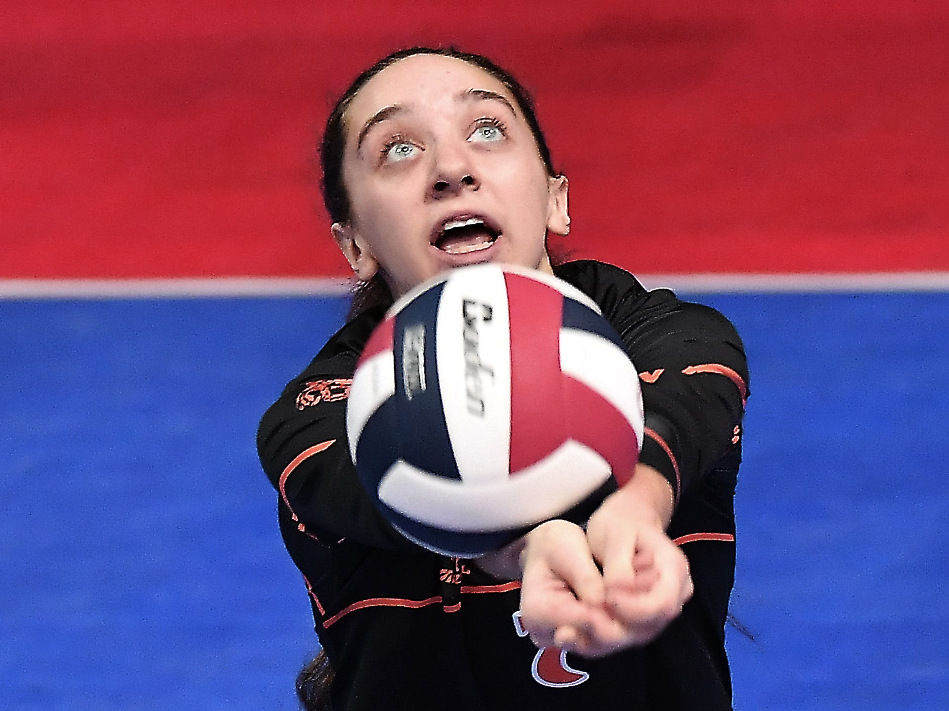 Brenna Osksa of Plentywood digs the ball against Manhattan Christian at the All-Class State Volleyball Tournament at the Brick Breeden Fieldhouse in Bozeman.