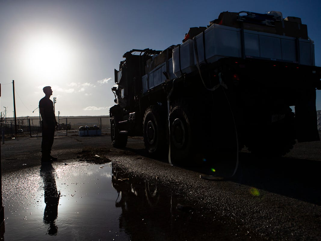 A Marine with Combat Logistics Battalion 31 inspects a load of U.S. Federal Emergency Management Agency-provided emergency shelters sitting on a 7-ton flatbed truck before delivery to residents of Tinian, Commonwealth of the Northern Mariana Islands, Nov. 7, 2018. Marines and Sailors with the 31st Marine Expeditionary Unit and CLB-31 arrived on Tinian Oct. 29-31 to lead relief efforts on Tinian in response to Super Typhoon Yutu as part of Task Force-West. TF-W is leading the Department of Defense's efforts to assist CNMI's local and civil authorities provide critical assistance for citizens devastated by Yutu, which struck Tinian and Saipan Oct. 25 as the second largest storm to ever hit U.S. soil. The 31st MEU, the Marine Corps' only continuously forward-deployed MEU, provides a flexible force ready to perform a wide-range of military operations across the Indo-Pacific region. (U.S. Marine Corps photo by Gunnery Sgt. T. T. Parish/Released)