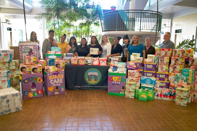 Women and Gender Studies students at the University of Guam donated diapers and various other products to Alee Shelter, an emergency shelter for victims of domestic violence and sexual assault in Guam. The donation followed a two-week Nene Care Diaper Drive, a service project the students organized in honor of Domestic Violence Awareness Month. Pictured from left: Kristine Lujan, vice president – marketing and public relations, Triple J Enterprises; Jester Calalang; Victoria Botelho, both freshmen at UOG; Diana Calvo, executive director; Benalyn Naputi, social worker, both of Alee Shelter; CJ Joab, UOG junior; Deane Jessee-Jones, instructor of Women and Gender Studies at UOG; Yvonne Johnny, UOG senior; Esther Chun, UOG junior; Sharleen Santos-Bamba, associate professor at UOG and acting associate dean of the College of Liberal Arts and Social Sciences; Ann Ames, associate professor of sociology at UOG; and James Sellman, dean of the College of Liberal Arts and Social Sciences.