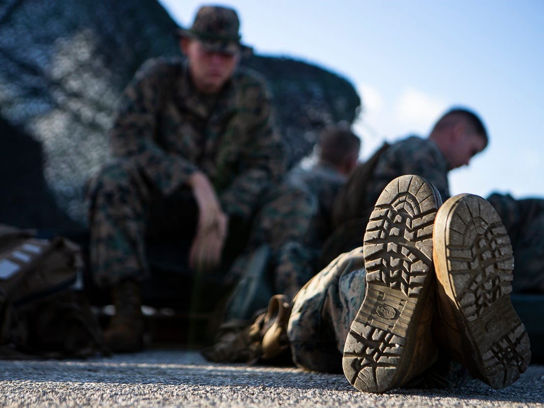 Marines with Combat Logistics Battalion 31 wait at the port before beginning the day delivering U.S. Federal Emergency Management Agency-provided emergency shelters for residents of Tinian, Commonwealth of the Northern Mariana Islands, Nov. 7, 2018. Marines and Sailors with the 31st Marine Expeditionary Unit and CLB-31 arrived on Tinian Oct. 29-31 to lead relief efforts on Tinian in response to Super Typhoon Yutu as part of Task Force-West. TF-W is leading the Department of Defense's efforts to assist CNMI's local and civil authorities provide critical assistance for citizens devastated by Yutu, which struck Tinian and Saipan Oct. 25 as the second largest storm to ever hit U.S. soil. The 31st MEU, the Marine Corps' only continuously forward-deployed MEU, provides a flexible force ready to perform a wide-range of military operations across the Indo-Pacific region. (U.S. Marine Corps photo by Gunnery Sgt. T. T. Parish/Released)