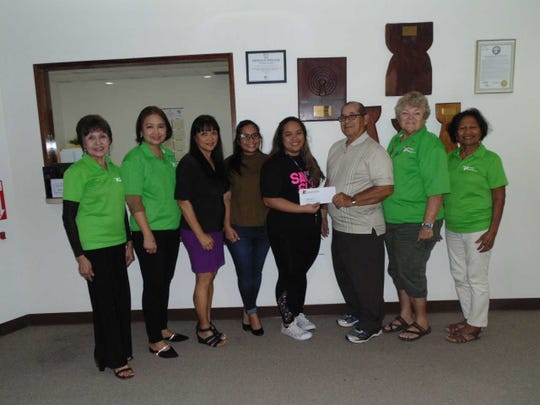 Guam Diabetes Association is presented a check from Micronesian Brokers Inc., a gold sponsor of the 19th annual Guam Diabetes Conference.