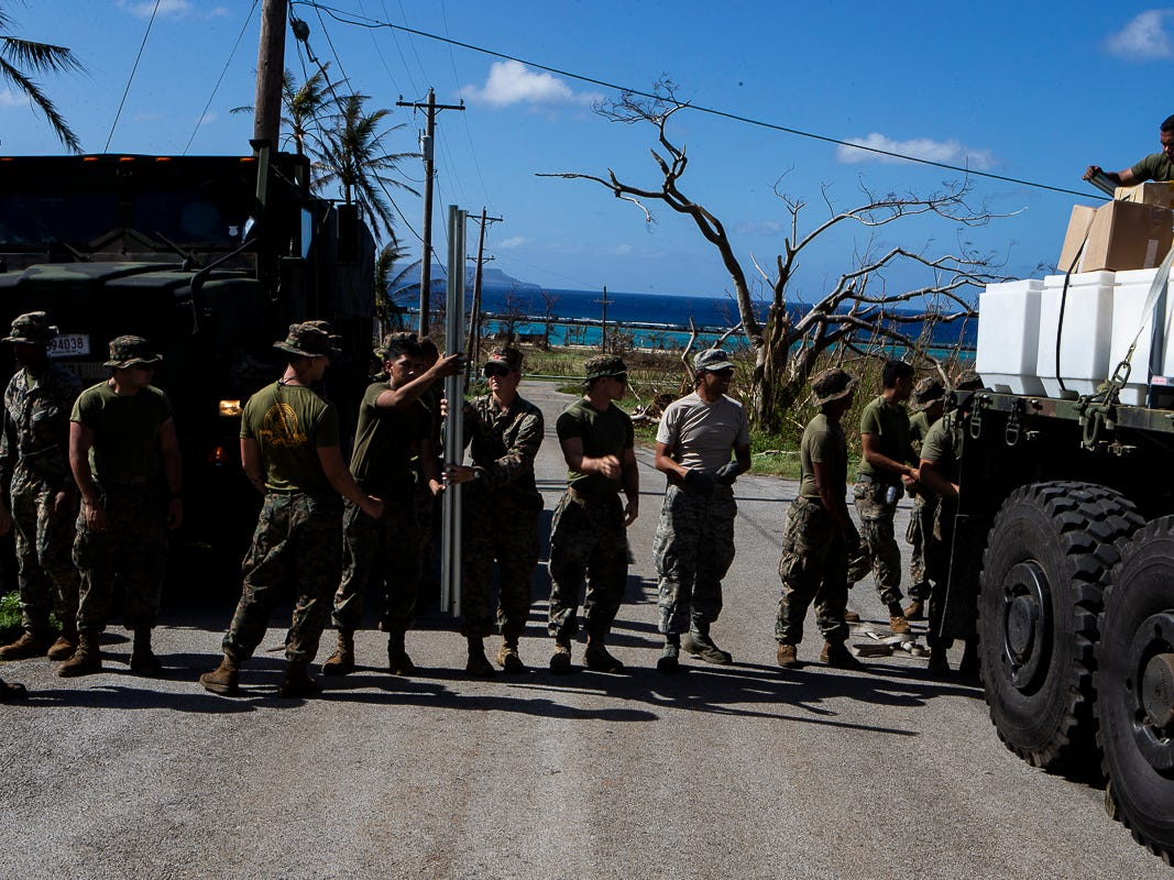 Marines with Combat Logistics Battalion 31 unload a 7-ton flatbed truck while delivering U.S. Federal Emergency Management Agency-provided emergency shelters for residents of Tinian, Commonwealth of the Northern Mariana Islands, Nov. 7, 2018. Marines and Sailors with the 31st Marine Expeditionary Unit and CLB-31 are assisting local and civil authorities on Tinian to deliver FEMA shelters for families affected by Super Typhoon Yutu, which struck here Oct. 25 as the second strongest storm to ever hit U.S. soil. Marines and Sailors with the 31st MEU and CLB-31 arrived on Tinian Oct. 29-31 to lead relief efforts on Tinian in response to Yutu as part of Task Force-West. TF-W is leading the Department of Defense's efforts to assist CNMI's local and civil authorities provide critical assistance for citizens devastated by Yutu. The 31st MEU, the Marine Corps' only continuously forward-deployed MEU, provides a flexible force ready to perform a wide-range of military operations across the Indo-Pacific region. (U.S. Marine Corps photo by Gunnery Sgt. T. T. Parish/Released)