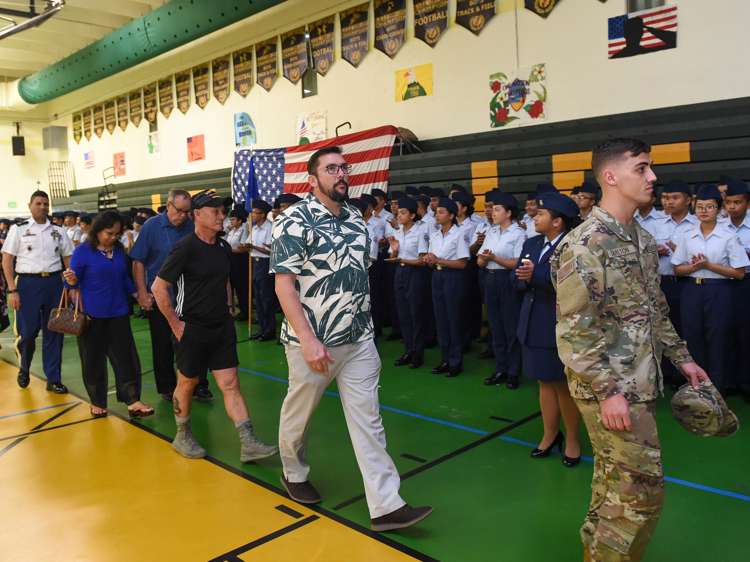 Veterans and dignitaries march in the Veterans' Parade during the John F. Kennedy High School Veterans Recognition Ceremony, Nov. 9, 2018.
