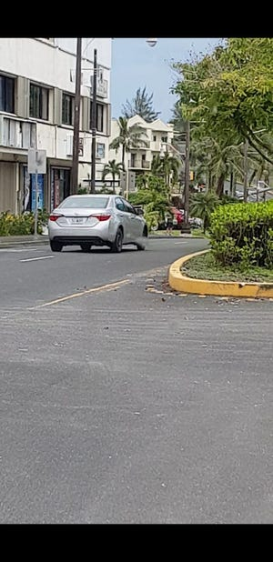 The car suspected in an Oct. 17 purse snatching that happened during the day on Fujita Road in Tumon.