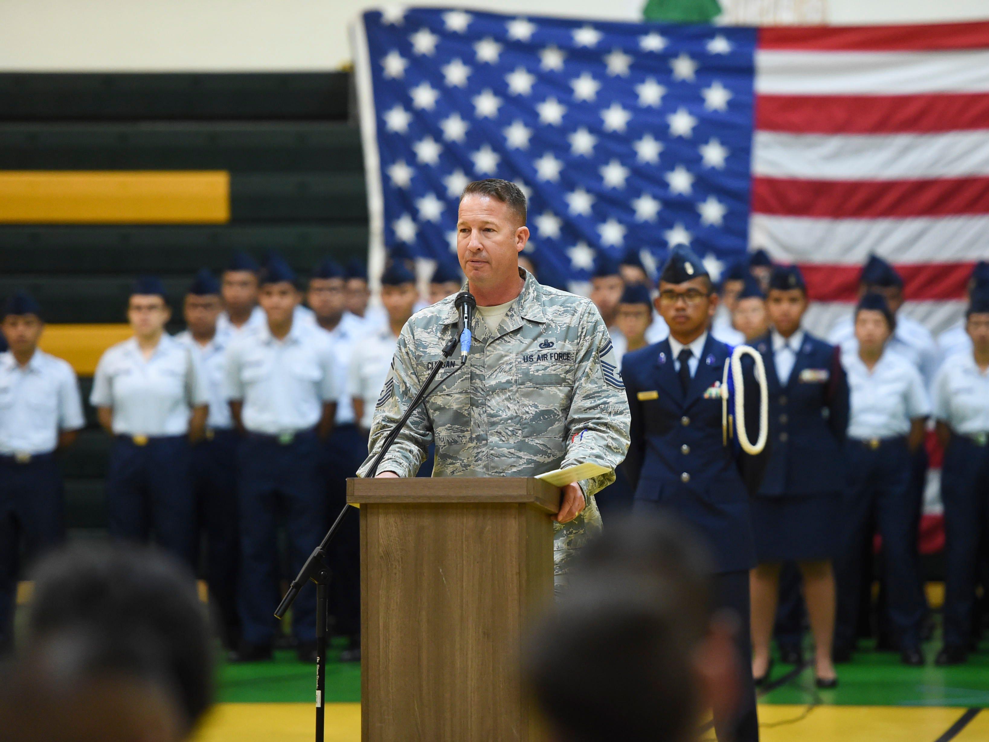 Senior Master Sgt. Adam Clingan speaks during the JFK High School Veterans Recognition Ceremony, Nov. 9, 2018.