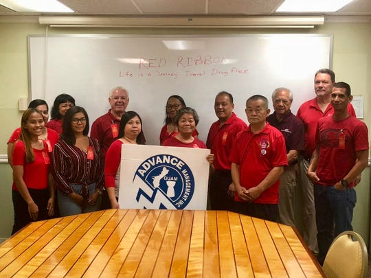"Advance Management, Inc. staff wore red on Oct. 26 to support Red Ribbon Week held Oct. 23-31. The Red Ribbon campaign honors Drug Enforcement Agent Enrique ""Kiki"" Camarena, who was killed in the line of duty, and encourages youth to live a healthy drug-free life."