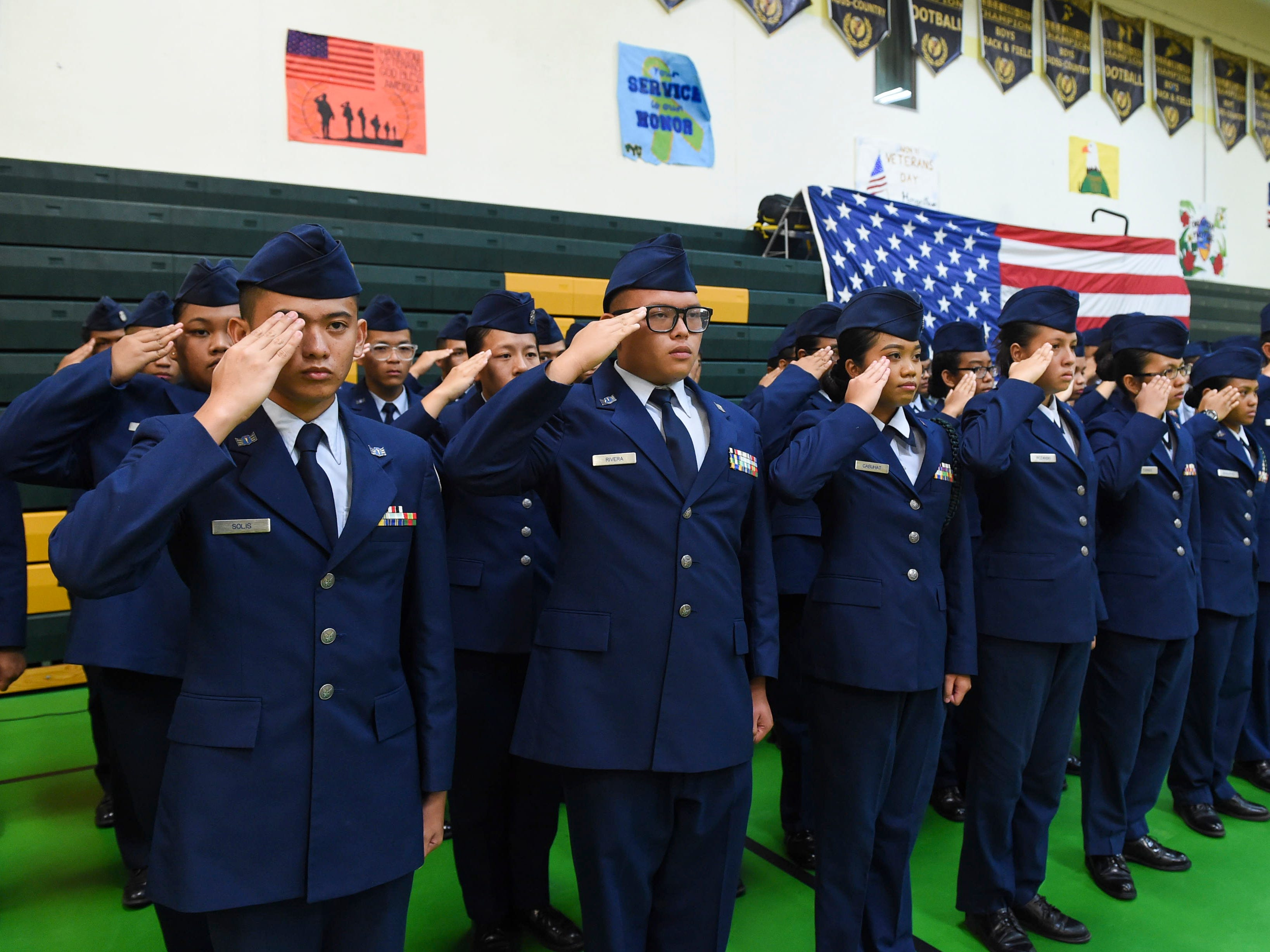 The John F. Kennedy High School Air Force Junior ROTC team stands at attention during the JFK High School Veterans Recognition Ceremony, Nov. 9, 2018.
