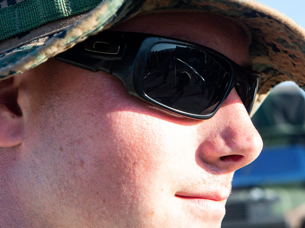 Staff Sgt. Justin Blankenship, a 25-year-old tank mechanic with Combat Logistics Battalion 31, looks on as Seabees with Naval Mobile Construction Battalion 1 assemble a U.S. Federal Emergency Management Agency-provided emergency shelter, Tinian, Commonwealth of the Northern Mariana Islands, Nov. 7, 2018. Blankenship is a native of Daytona Beach, Florida. Marines and Sailors with the 31st Marine Expeditionary Unit and CLB-31 are assisting local and civil authorities on Tinian to deliver FEMA shelters for families affected by Super Typhoon Yutu, which struck here Oct. 25 as the second strongest storm to ever hit U.S. soil. Marines and Sailors with the 31st MEU and CLB-31 arrived on Tinian Oct. 29-31 to lead relief efforts on Tinian in response to Yutu as part of Task Force-West. TF-W is leading the Department of Defense's efforts to assist CNMI's local and civil authorities provide critical assistance for citizens devastated by Yutu. The 31st MEU, the Marine Corps' only continuously forward-deployed MEU, provides a flexible force ready to perform a wide-range of military operations across the Indo-Pacific region. (U.S. Marine Corps photo by Gunnery Sgt. T. T. Parish/Released)