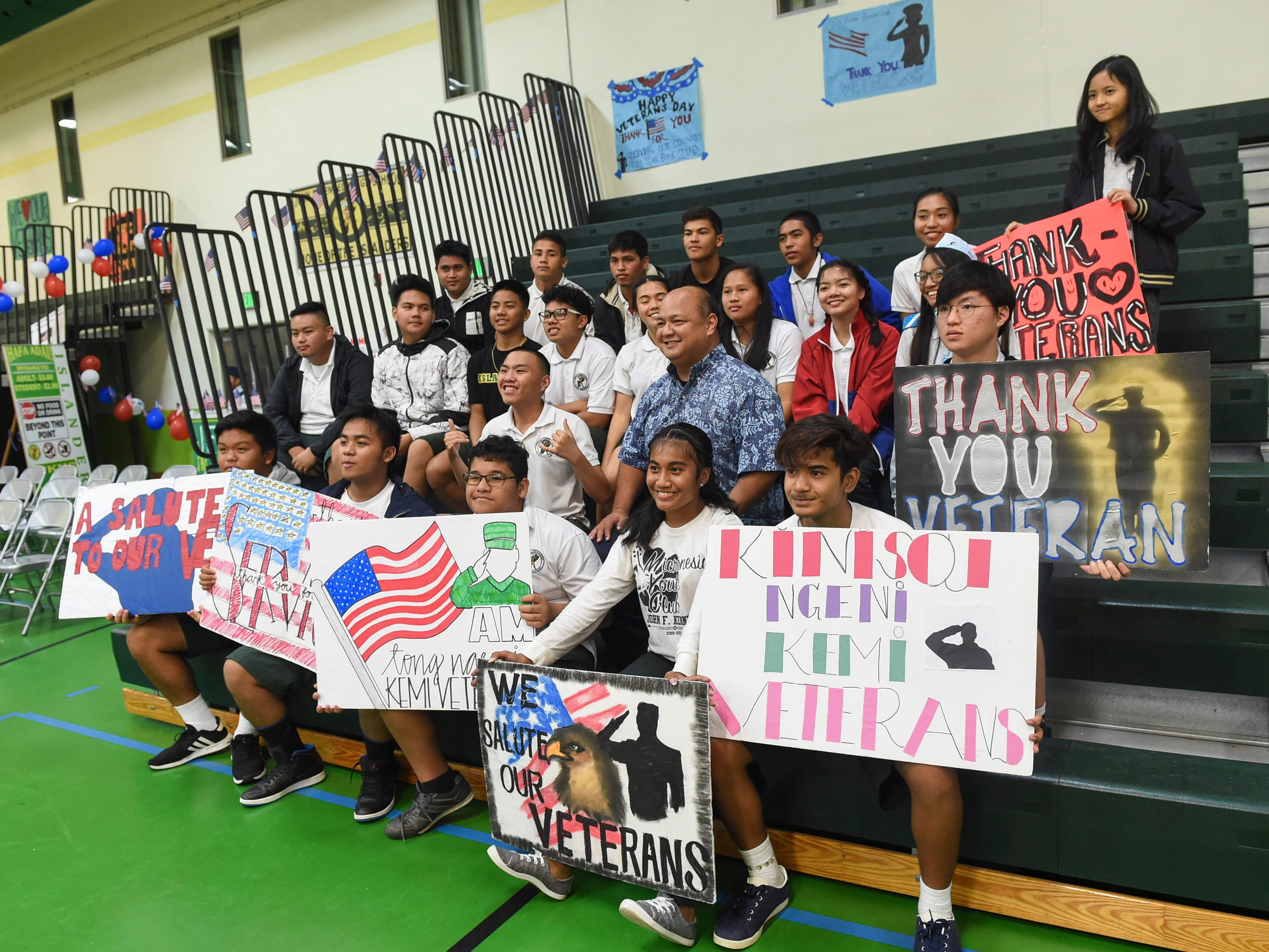 Guam Department of Education Superintendant Jon Fernandez takes a photo with John F. Kennedy High School students after the JFK High School Veterans Recognition Ceremony, Nov. 9, 2018.