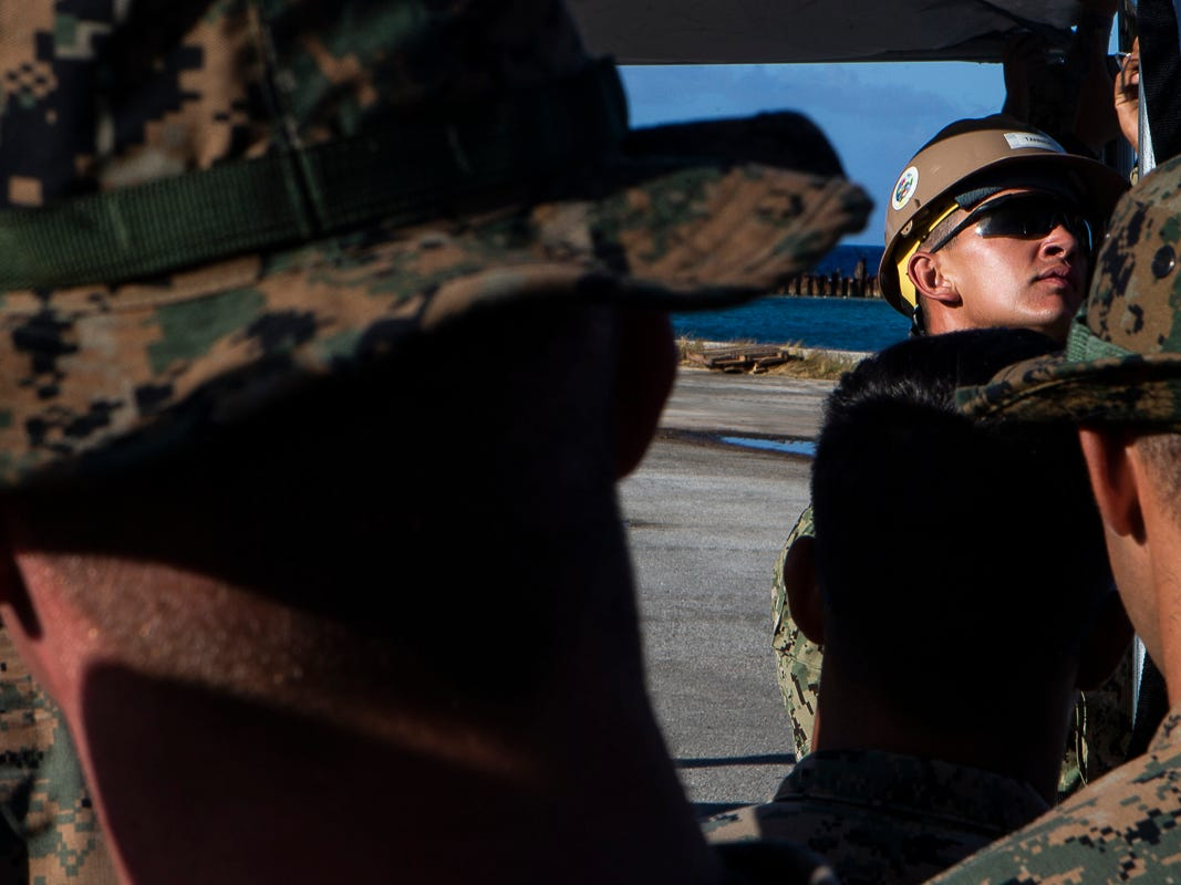 A Seabee with Naval Mobile Construction Battalion 1 helps assemble a U.S. Federal Emergency Management Agency-provided emergency shelter as Marines with Combat Logistics Battalion 31 look on, Tinian, Commonwealth of the Northern Mariana Islands, Nov. 7, 2018. Marines and Sailors with the 31st Marine Expeditionary Unit and CLB-31 are assisting local and civil authorities on Tinian to deliver FEMA shelters for families affected by Super Typhoon Yutu, which struck here Oct. 25 as the second strongest storm to ever hit U.S. soil. Marines and Sailors with the 31st MEU and CLB-31 arrived on Tinian Oct. 29-31 to lead relief efforts on Tinian in response to Yutu as part of Task Force-West. TF-W is leading the Department of Defense's efforts to assist CNMI's local and civil authorities provide critical assistance for citizens devastated by Yutu. The 31st MEU, the Marine Corps' only continuously forward-deployed MEU, provides a flexible force ready to perform a wide-range of military operations across the Indo-Pacific region. (U.S. Marine Corps photo by Gunnery Sgt. T. T. Parish/Released)