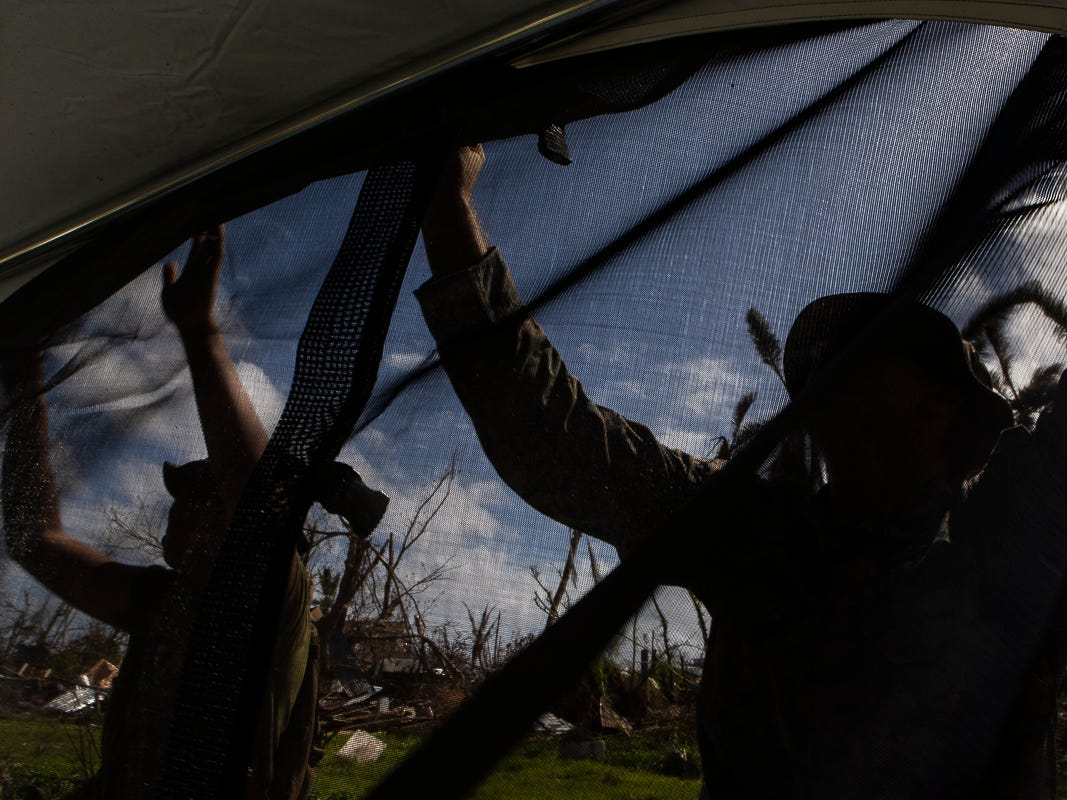 Marines with Combat Logistics Battalion 31 hang a mosquito net on a U.S. Federal Emergency Management Agency-provided emergency shelter for residents of Tinian, Commonwealth of the Northern Mariana Islands, Nov. 7, 2018. Marines and Sailors with the 31st Marine Expeditionary Unit and CLB-31 are assisting local and civil authorities on Tinian to deliver FEMA shelters for families affected by Super Typhoon Yutu, which struck here Oct. 25 as the second strongest storm to ever hit U.S. soil. Marines and Sailors with the 31st MEU and CLB-31 arrived on Tinian Oct. 29-31 to lead relief efforts on Tinian in response to Yutu as part of Task Force-West. TF-W is leading the Department of Defense's efforts to assist CNMI's local and civil authorities provide critical assistance for citizens devastated by Yutu. The 31st MEU, the Marine Corps' only continuously forward-deployed MEU, provides a flexible force ready to perform a wide-range of military operations across the Indo-Pacific region. (U.S. Marine Corps photo by Gunnery Sgt. T. T. Parish/Released)