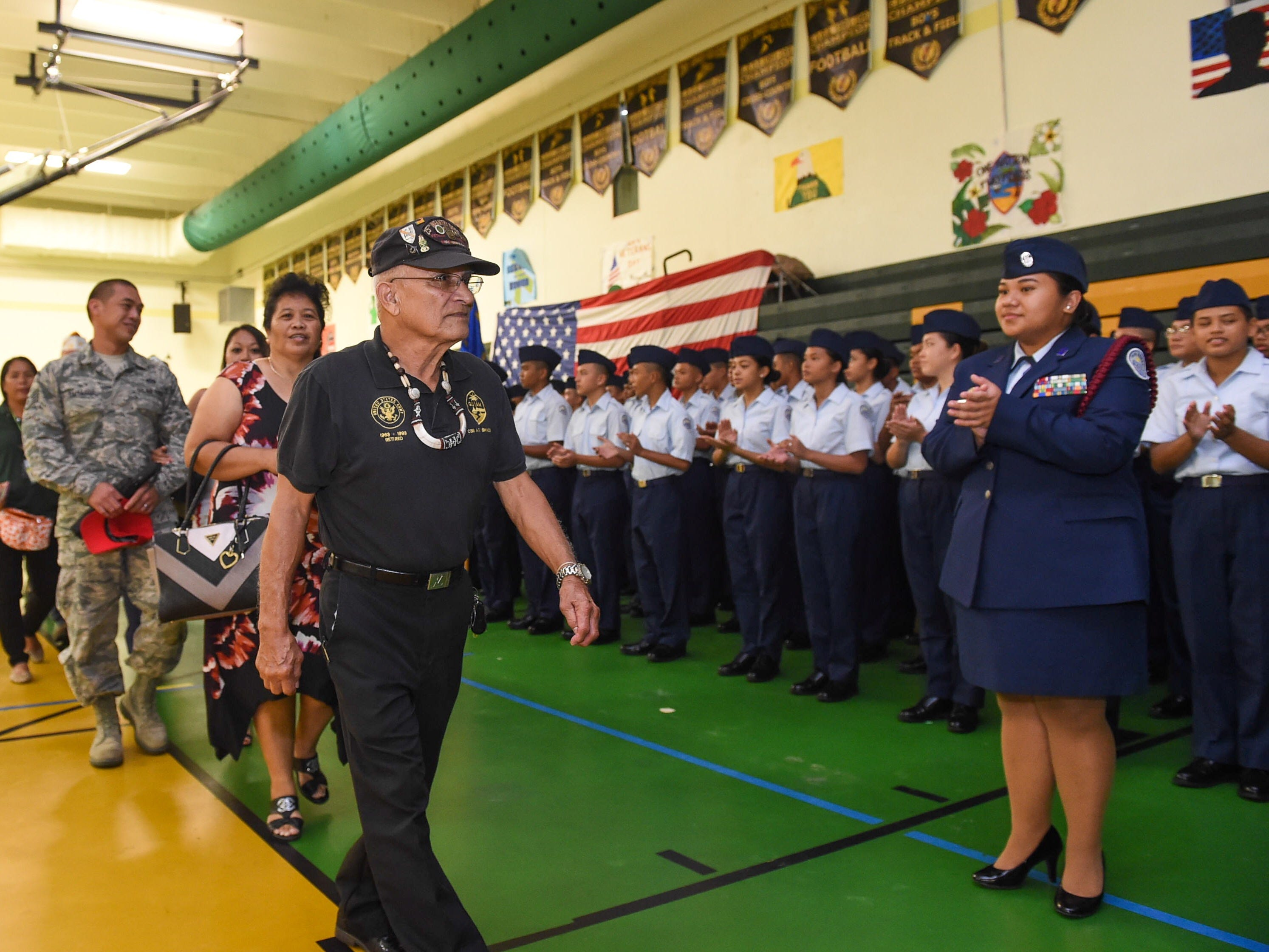 Veterans and guests parade into the gym for the John F. Kennedy High School Veterans Recognition Ceremony held on Friday, Nov. 9, 2018. JFK's Air Force Junior ROTC students coordinated the event ahead of  Sunday's Veterans Day.