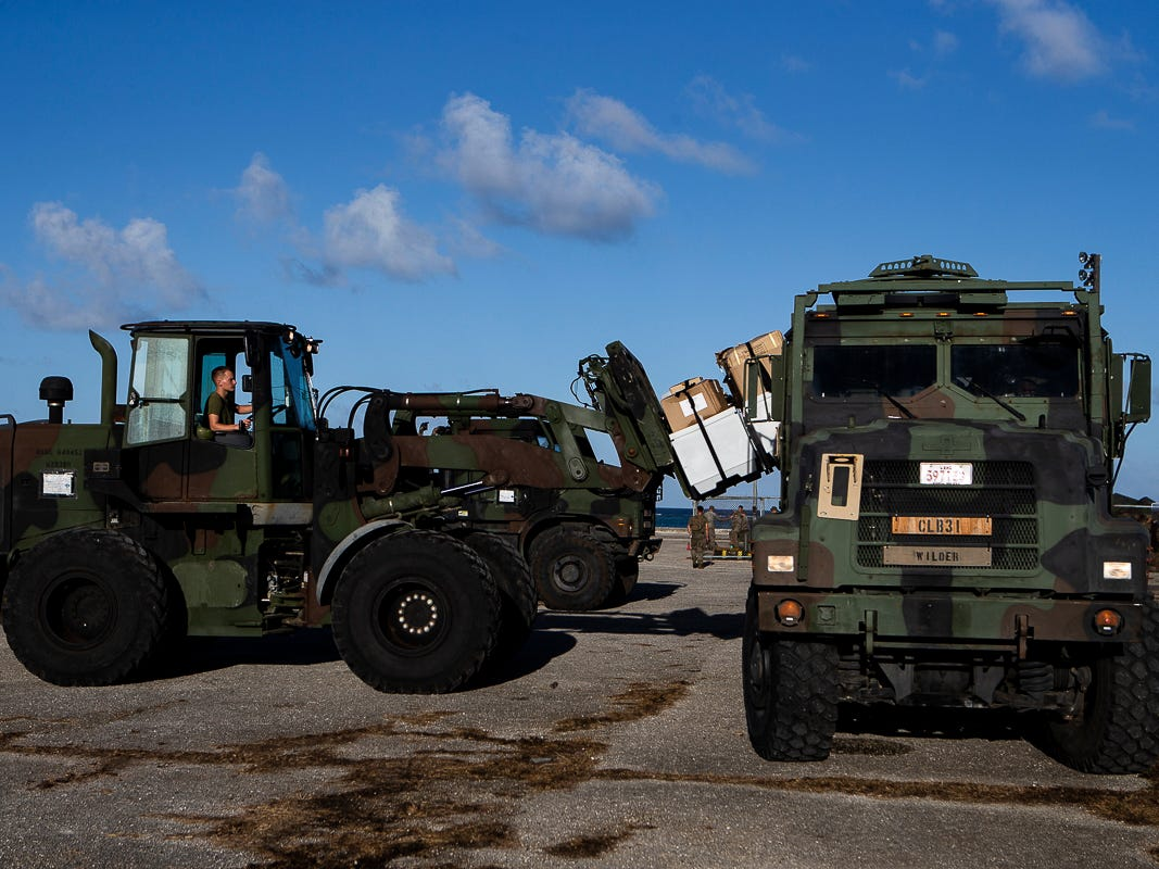 A Marine with Combat Logistics Battalion 31 loads U.S. Federal Emergency Management Agency-provided emergency shelters onto a 7-ton flatbed truck for delivery to residents of Tinian, Commonwealth of the Northern Mariana Islands, Nov. 7, 2018. Marines and Sailors with the 31st Marine Expeditionary Unit and CLB-31 arrived on Tinian Oct. 29-31 to lead relief efforts on Tinian in response to Super Typhoon Yutu as part of Task Force-West. TF-W is leading the Department of Defense's efforts to assist CNMI's local and civil authorities provide critical assistance for citizens devastated by Yutu, which struck Tinian and Saipan Oct. 25 as the second largest storm to ever hit U.S. soil. The 31st MEU, the Marine Corps' only continuously forward-deployed MEU, provides a flexible force ready to perform a wide-range of military operations across the Indo-Pacific region. (U.S. Marine Corps photo by Gunnery Sgt. T. T. Parish/Released)