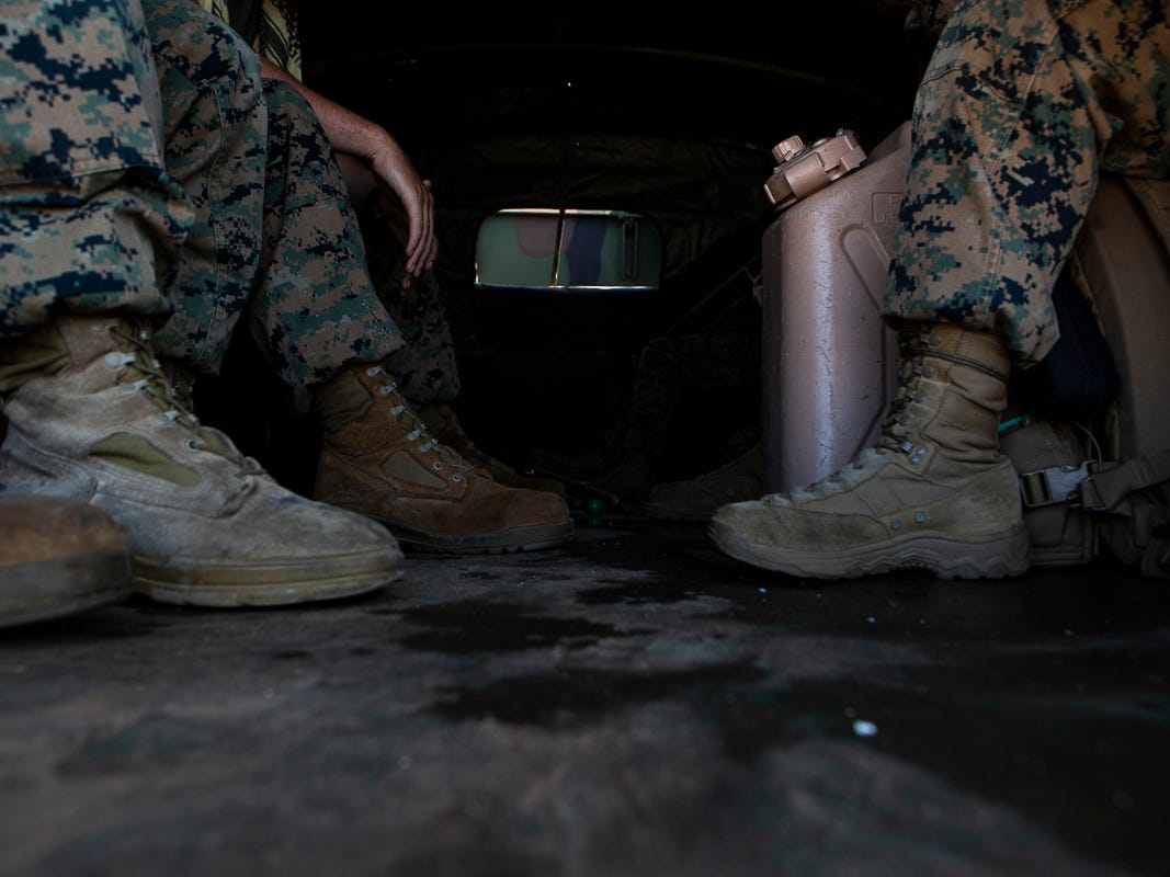 Marines with Combat Logistics Battalion 31 sit in the rear of a 7-ton flatbed truck while delivering U.S. Federal Emergency Management Agency-provided emergency shelters for residents of Tinian, Commonwealth of the Northern Mariana Islands, Nov. 7, 2018. Marines and Sailors with the 31st Marine Expeditionary Unit and CLB-31 are assisting local and civil authorities on Tinian to deliver FEMA shelters for families affected by Super Typhoon Yutu, which struck here Oct. 25 as the second strongest storm to ever hit U.S. soil. Marines and Sailors with the 31st MEU and CLB-31 arrived on Tinian Oct. 29-31 to lead relief efforts on Tinian in response to Yutu as part of Task Force-West. TF-W is leading the Department of Defense's efforts to assist CNMI's local and civil authorities provide critical assistance for citizens devastated by Yutu. The 31st MEU, the Marine Corps' only continuously forward-deployed MEU, provides a flexible force ready to perform a wide-range of military operations across the Indo-Pacific region. (U.S. Marine Corps photo by Gunnery Sgt. T. T. Parish/Released)