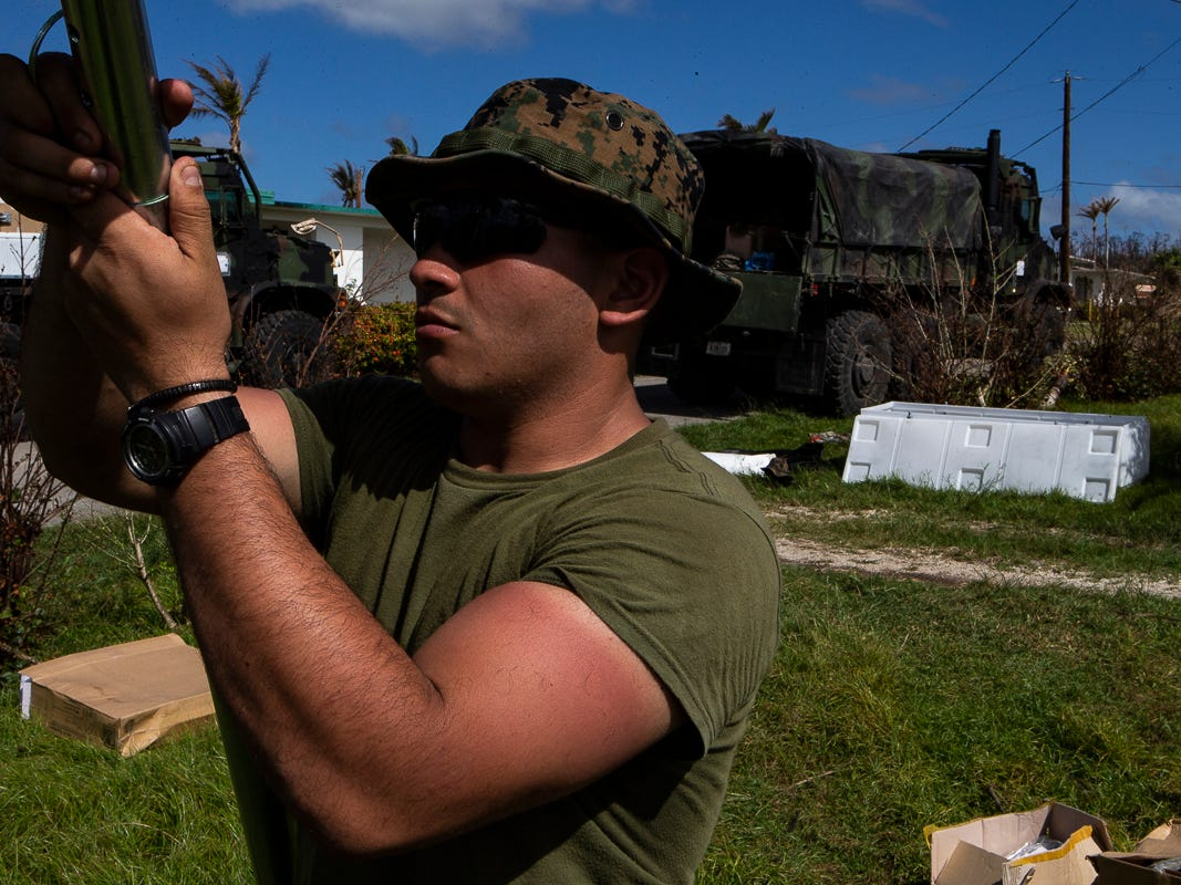 Lance Cpl. John Dheming, a 19-year-old electrician with Combat Logistics Battalion 31, helps assemble a U.S. Federal Emergency Management Agency-provided emergency shelter for residents of Tinian, Commonwealth of the Northern Mariana Islands, Nov. 7, 2018. Deheming, a native of Irving, Texas, graduated from Nimitz High School in June 2017 before enlisting in August the same year. Marines and Sailors with the 31st Marine Expeditionary Unit and CLB-31 are assisting local and civil authorities on Tinian to deliver FEMA shelters for families affected by Super Typhoon Yutu, which struck here Oct. 25 as the second strongest storm to ever hit U.S. soil. Marines and Sailors with the 31st MEU and CLB-31 arrived on Tinian Oct. 29-31 to lead relief efforts on Tinian in response to Yutu as part of Task Force-West. TF-W is leading the Department of Defense's efforts to assist CNMI's local and civil authorities provide critical assistance for citizens devastated by Yutu. The 31st MEU, the Marine Corps' only continuously forward-deployed MEU, provides a flexible force ready to perform a wide-range of military operations across the Indo-Pacific region. (U.S. Marine Corps photo by Gunnery Sgt. T. T. Parish/Released)