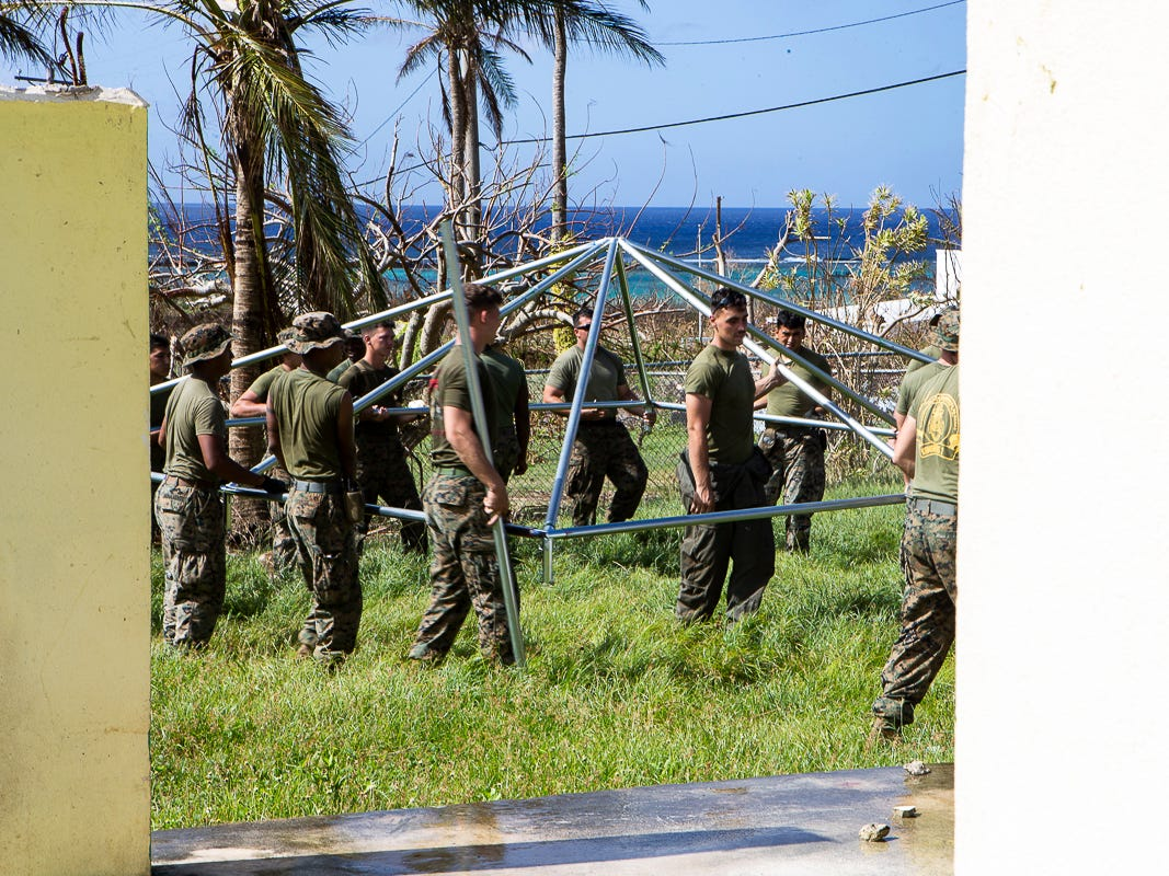 Marines with Combat Logistics Battalion 31 assemble a U.S. Federal Emergency Management Agency-provided emergency shelter for residents of Tinian, Commonwealth of the Northern Mariana Islands, Nov. 7, 2018. Marines and Sailors with the 31st Marine Expeditionary Unit and CLB-31 are assisting local and civil authorities on Tinian to deliver FEMA shelters for families affected by Super Typhoon Yutu, which struck here Oct. 25 as the second strongest storm to ever hit U.S. soil. Marines and Sailors with the 31st MEU and CLB-31 arrived on Tinian Oct. 29-31 to lead relief efforts on Tinian in response to Yutu as part of Task Force-West. TF-W is leading the Department of Defense's efforts to assist CNMI's local and civil authorities provide critical assistance for citizens devastated by Yutu. The 31st MEU, the Marine Corps' only continuously forward-deployed MEU, provides a flexible force ready to perform a wide-range of military operations across the Indo-Pacific region. (U.S. Marine Corps photo by Gunnery Sgt. T. T. Parish/Released)