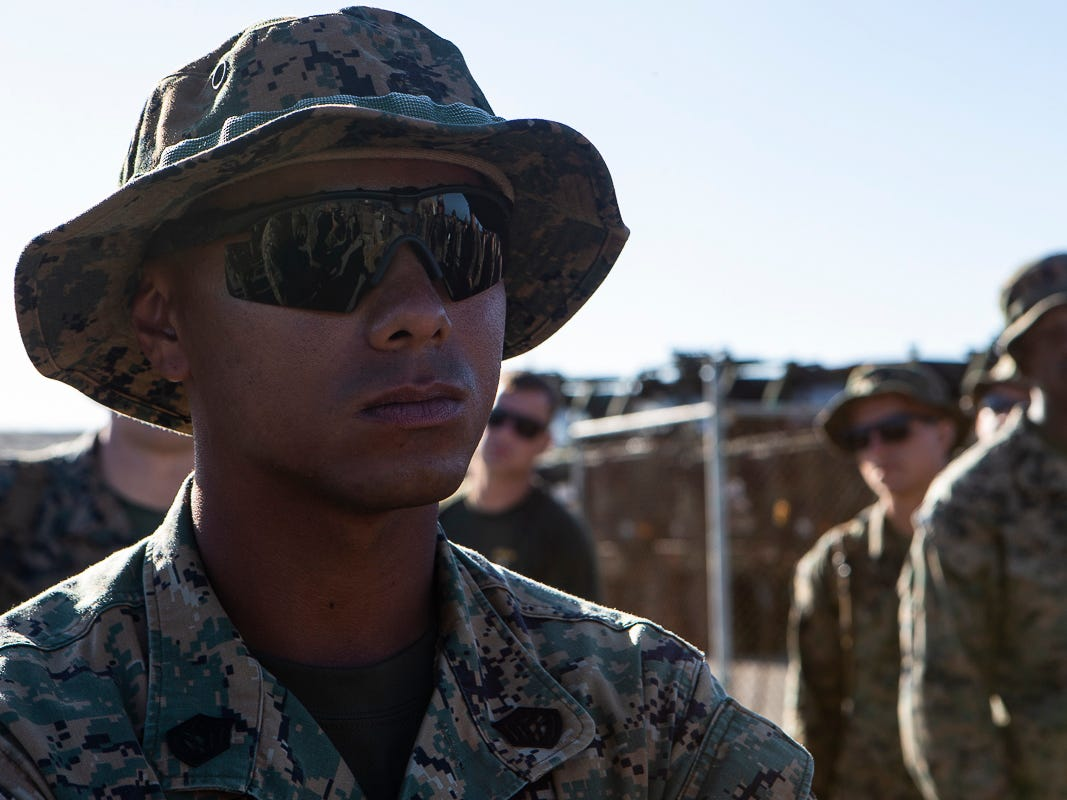 Gunnery Sgt. Angel Ignacio, a native of Guam and battalion gunnery sergeant with Combat Logistics Battalion 31, looks on as Seabees with Naval Mobile Construction Battalion 1 assemble a U.S. Federal Emergency Management Agency-provided emergency shelter, Tinian, Commonwealth of the Northern Mariana Islands, Nov. 7, 2018. Marines and Sailors with the 31st Marine Expeditionary Unit and CLB-31 are assisting local and civil authorities on Tinian to deliver FEMA shelters for families affected by Super Typhoon Yutu, which struck here Oct. 25 as the second strongest storm to ever hit U.S. soil. Marines and Sailors with the 31st MEU and CLB-31 arrived on Tinian Oct. 29-31 to lead relief efforts on Tinian in response to Yutu as part of Task Force-West. TF-W is leading the Department of Defense's efforts to assist CNMI's local and civil authorities provide critical assistance for citizens devastated by Yutu. The 31st MEU, the Marine Corps' only continuously forward-deployed MEU, provides a flexible force ready to perform a wide-range of military operations across the Indo-Pacific region. (U.S. Marine Corps photo by Gunnery Sgt. T. T. Parish/Released)