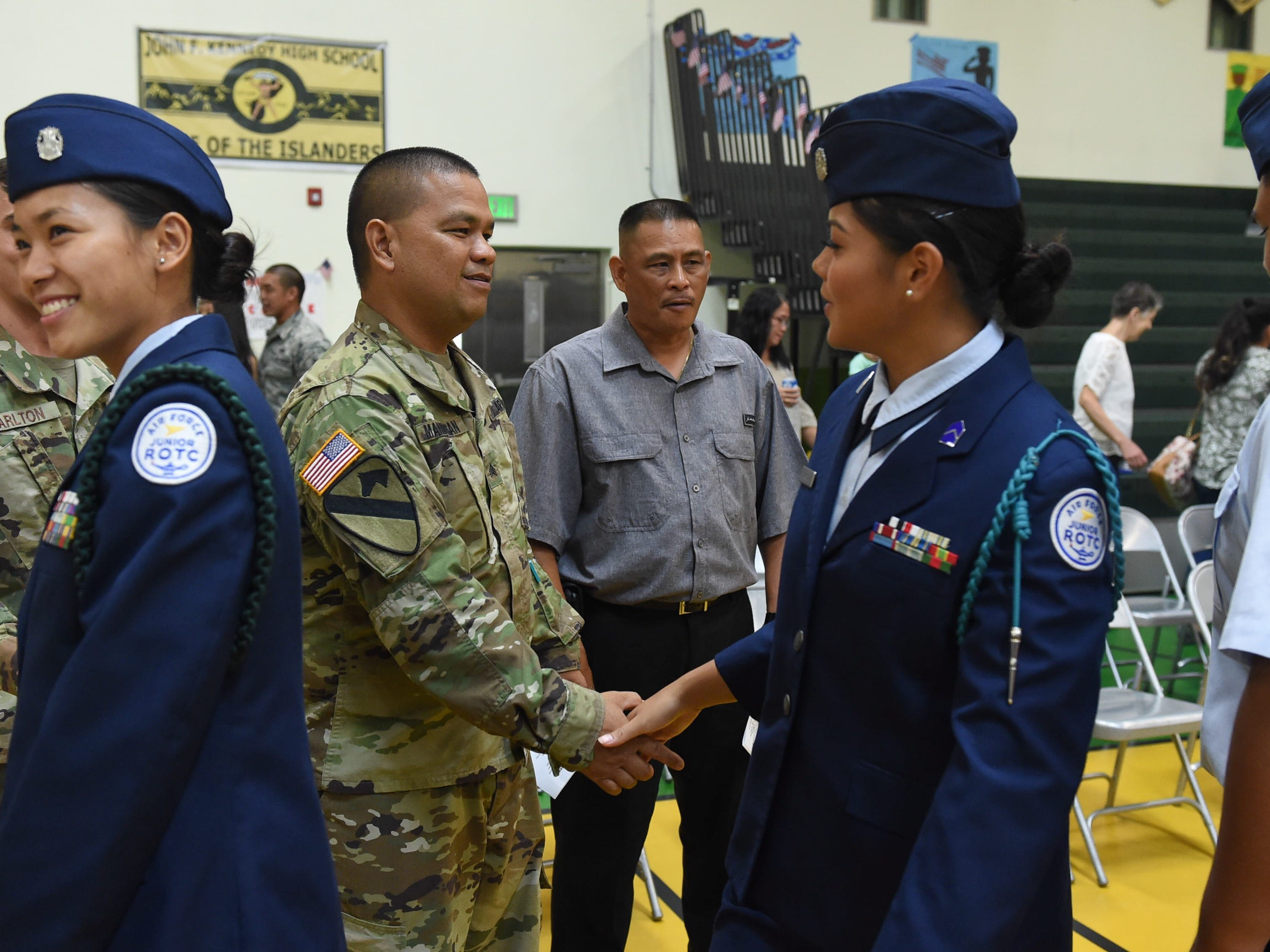 School Air Force ROTC students greet veterans after the JFK High School Veterans Recognition Ceremony, Nov. 9, 2018.