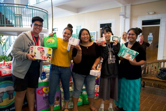 The drive collected items from the local community, the UOG community, and the business community, including a pallet of items donated from Ambros Inc. Triple J Auto Group assisted with the drive and served as a drop-off location. Pictured from left: Women and Gender Studies students Jester Calalang, freshman; Victoria Botelho, freshman; CJ Joab, junior; Esther Chun, junior; Yvonne Johnny, senior.