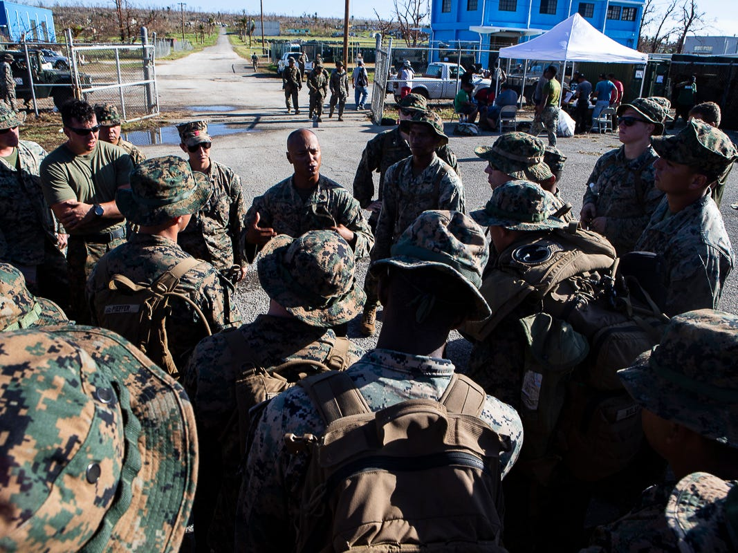 Gunnery Sgt. Angel Ignacio, a native of Guam and battalion gunnery sergeant with Combat Logistics Battalion 31, speaks with members of the battalion before beginning the day delivering U.S. Federal Emergency Management Agency-provided emergency shelters for residents of Tinian, Commonwealth of the Northern Mariana Islands, Nov. 7, 2018. Marines and Sailors with the 31st Marine Expeditionary Unit and CLB-31 are assisting local and civil authorities on Tinian to deliver FEMA shelters for families affected by Super Typhoon Yutu, which struck here Oct. 25 as the second strongest storm to ever hit U.S. soil. Marines and Sailors with the 31st MEU and CLB-31 arrived on Tinian Oct. 29-31 to lead relief efforts on Tinian in response to Yutu as part of Task Force-West. TF-W is leading the Department of Defense's efforts to assist CNMI's local and civil authorities provide critical assistance for citizens devastated by Yutu. The 31st MEU, the Marine Corps' only continuously forward-deployed MEU, provides a flexible force ready to perform a wide-range of military operations across the Indo-Pacific region. (U.S. Marine Corps photo by Gunnery Sgt. T. T. Parish/Released)