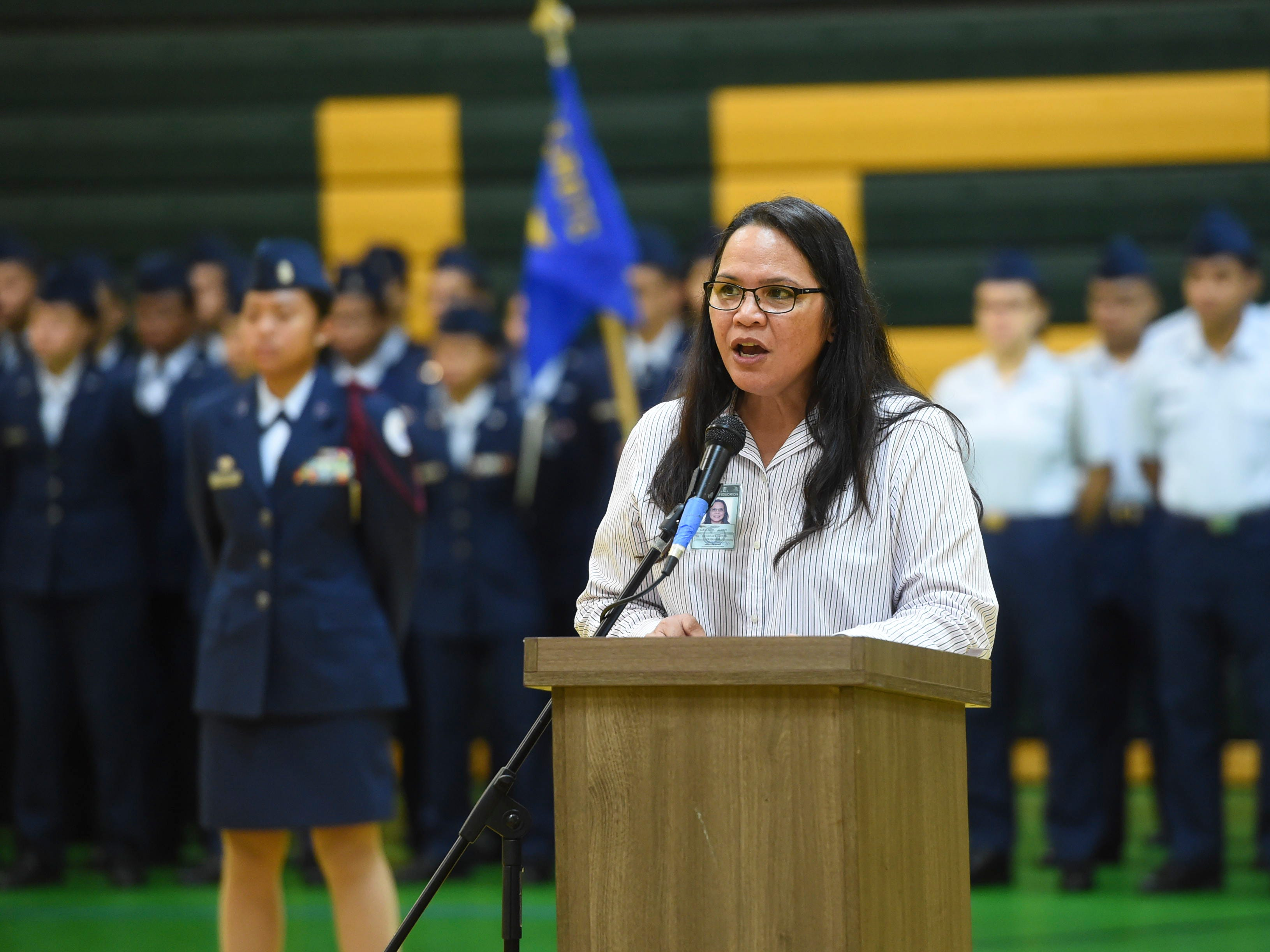 John F. Kennedy High School Principal Barbara Adamos gives her opening remarks during the JFK High School Veterans Recognition Ceremony, Nov. 9, 2018.