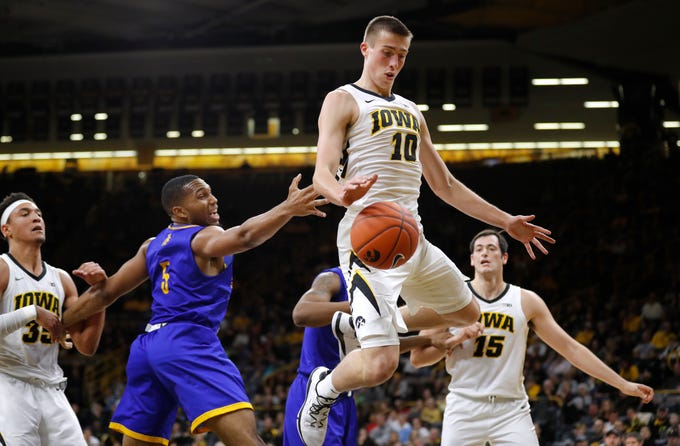 Iowa guard Joe Wieskamp (10) fights for a rebound with UKMC forward Jordan Giles (5) during the first half of an NCAA college basketball game, Thursday, Nov. 8, 2018, in Iowa City, Iowa.