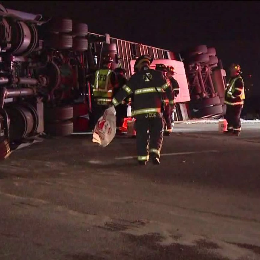 Truck carrying 40,000 pounds of ham overturns on I-65
