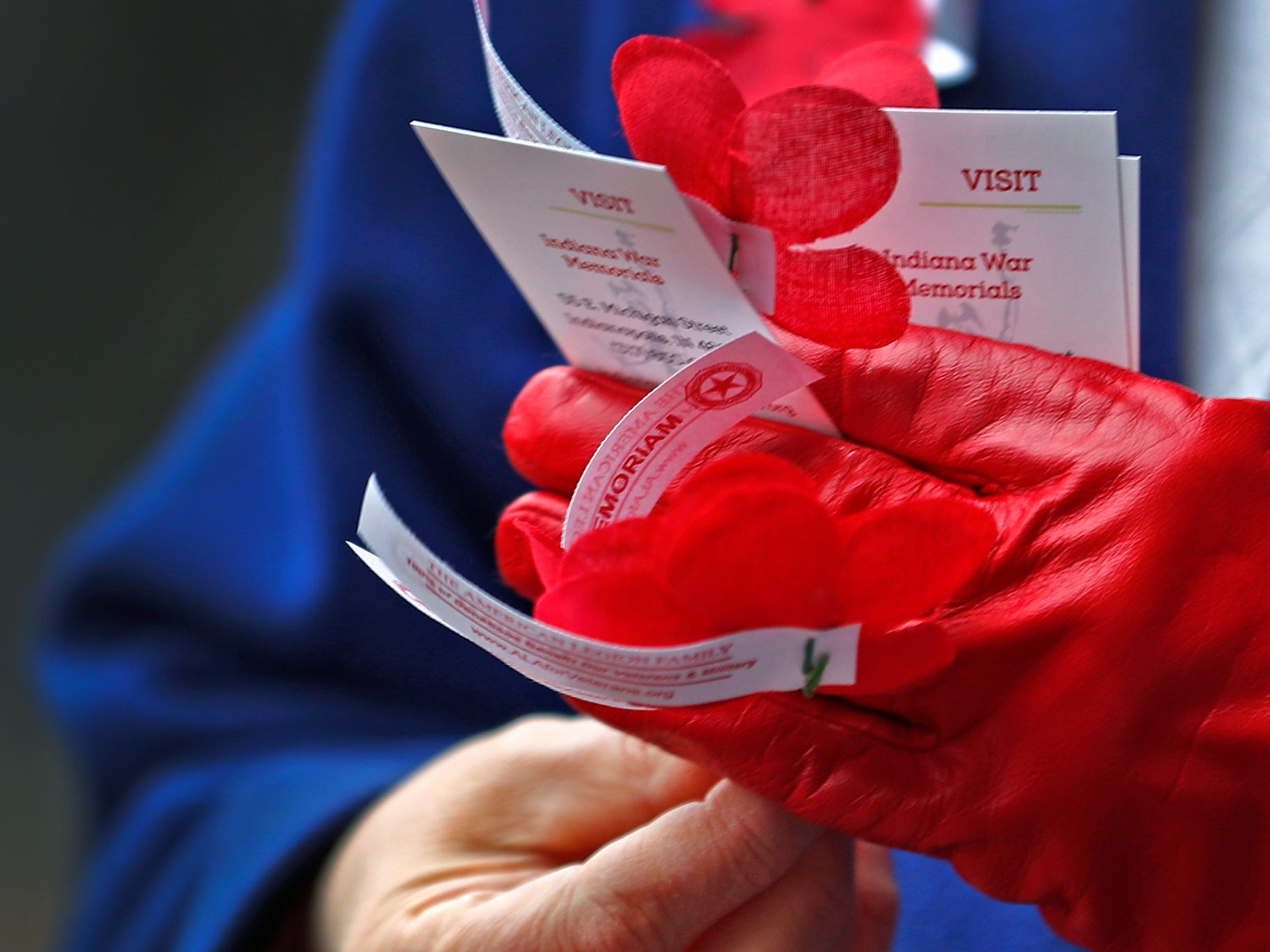 Marie Beason, Executive Director of the Indiana War Memorials Foundation, gives away free Remembrance Poppies from the Indiana War Memorials Foundation (IWMF) and Emmis Communications, on Monument Circle, Friday, Nov. 9, 2018.  The flower give-away is in celebration of Veterans Day and the 100th anniversary of the end of World War I.