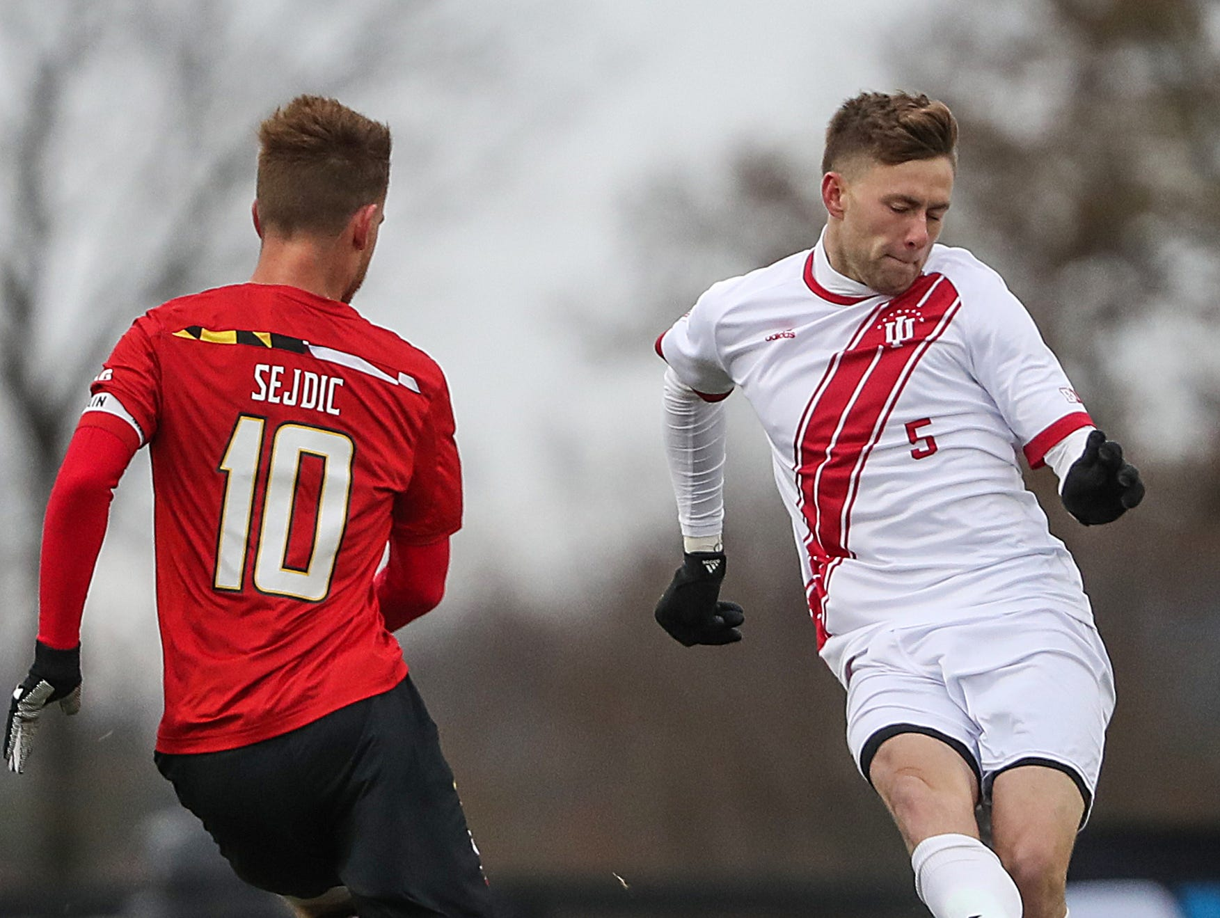 Indiana Hoosiers Grant Lillard (5) moves the ball past Maryland Terrapins midfielder Amar Sejdic (10) during the first half of Big Ten semifinals at Grand Park in Westfield, Ind., Friday, Nov. 9, 2018. Indiana and Maryland tied 1-1, with the Hoosiers advancing in penalty kicks, 4-3.