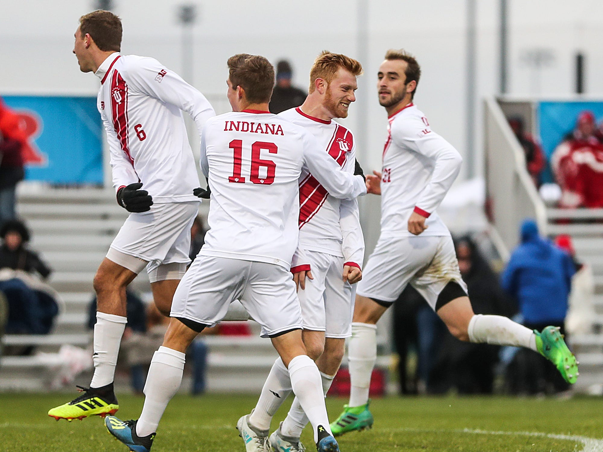 The Indiana Hoosiers celebrate defeating the Maryland Terrapins in Big Ten semifinals at Grand Park in Westfield, Ind., Friday, Nov. 9, 2018. Indiana and Maryland tied 1-1, with the Hoosiers clinching the win in penalty kicks, 4-3, with a goal by Indiana Hoosiers Cory Thomas (11), pictured second from right.