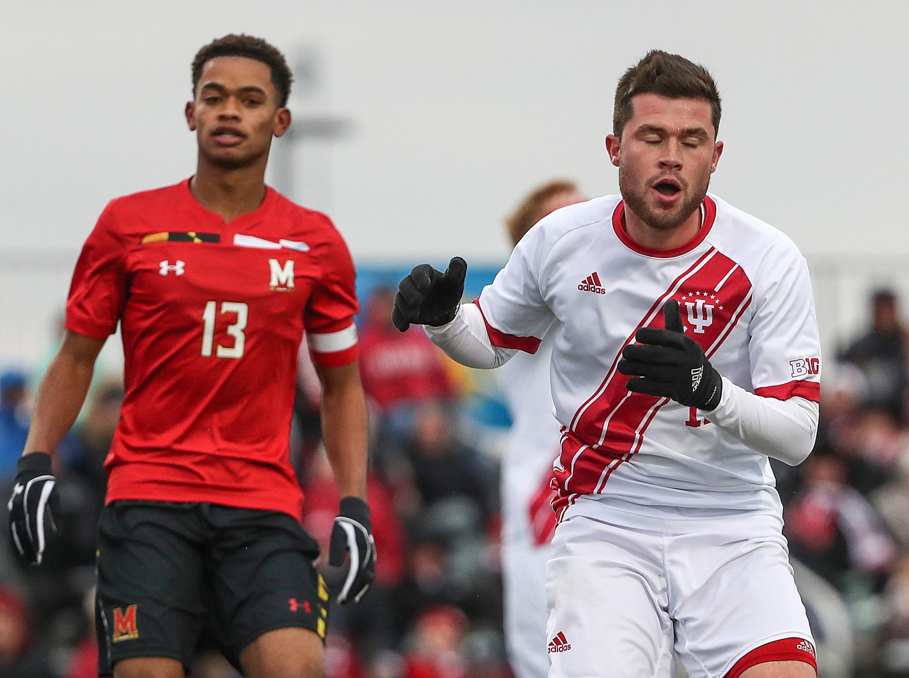 Right, Indiana Hoosiers Austin Panchot (12) reacts after missing a shot at the goal during the first half of Big Ten semifinals at Grand Park in Westfield, Ind., Friday, Nov. 9, 2018. Indiana and Maryland tied 1-1, with the Hoosiers advancing in penalty kicks, 4-3.
