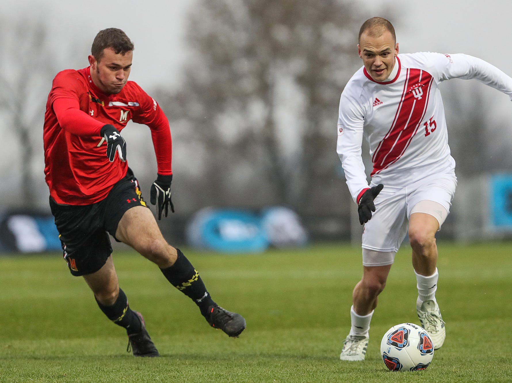 Maryland Terrapins forward Justin Gielen (7) guards Indiana Hoosiers Andrew Gutman (15) as he moves the ball during the first half of Big Ten semifinals at Grand Park in Westfield, Ind., Friday, Nov. 9, 2018. Indiana and Maryland tied 1-1, with the Hoosiers advancing in penalty kicks, 4-3.