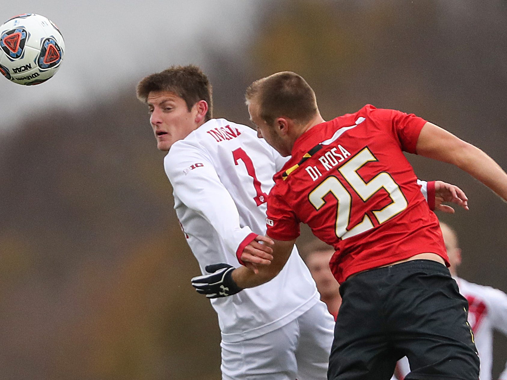 Indiana Hoosiers Trevor Swartz (7) and Maryland Terrapins defender Ben Di Rosa (25) go airborne for a header during the first half of Big Ten semifinals at Grand Park in Westfield, Ind., Friday, Nov. 9, 2018. Indiana and Maryland tied 1-1, with the Hoosiers advancing in penalty kicks, 4-3.