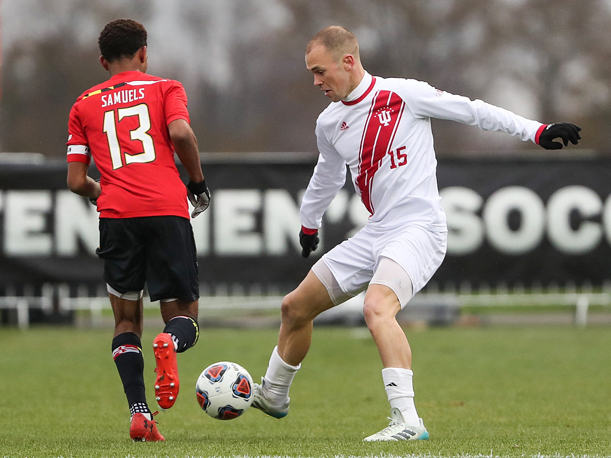 Maryland Terrapins Andrew Samuels (13) defends against Indiana Hoosiers Andrew Gutman (15) during the first half of Big Ten semifinals at Grand Park in Westfield, Ind., Friday, Nov. 9, 2018. Indiana and Maryland tied 1-1, with the Hoosiers advancing in penalty kicks, 4-3.