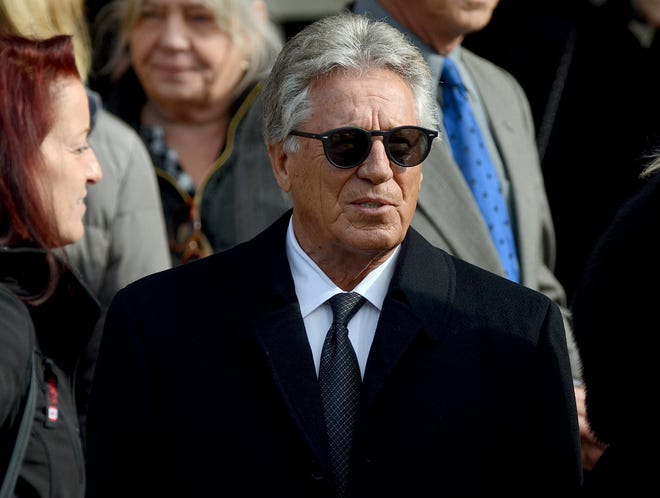 1969 Indianapolis 500 winner Mario Andretti walks out of St. Benedict Church after the memorial Mass for Mari Hulman George on Thursday.
