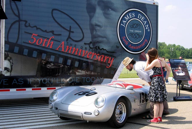 Sarah Moison-Thomas, 16, and her father John Thomas, 54, of West Lafayette, take a look at a replica of the Porsche Spyder 550 that James Dean was driving when he died 30 September 1955, during their visit of in James Dean's birthplace, in Marion, Indiana state, 04 June 2005.