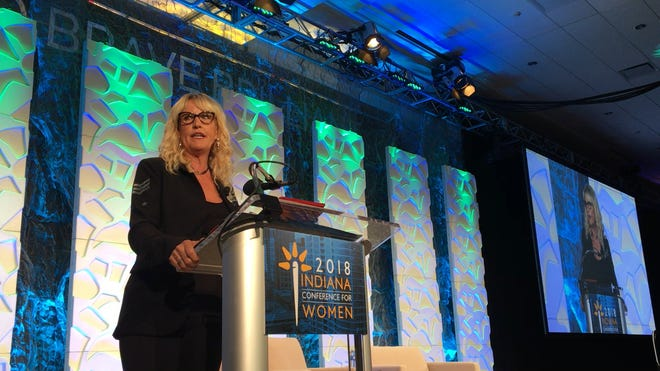 Erin Brockovich addresses attendees at the 2018 Indian Conference for Women in Indianapolis on November 8, 2018.