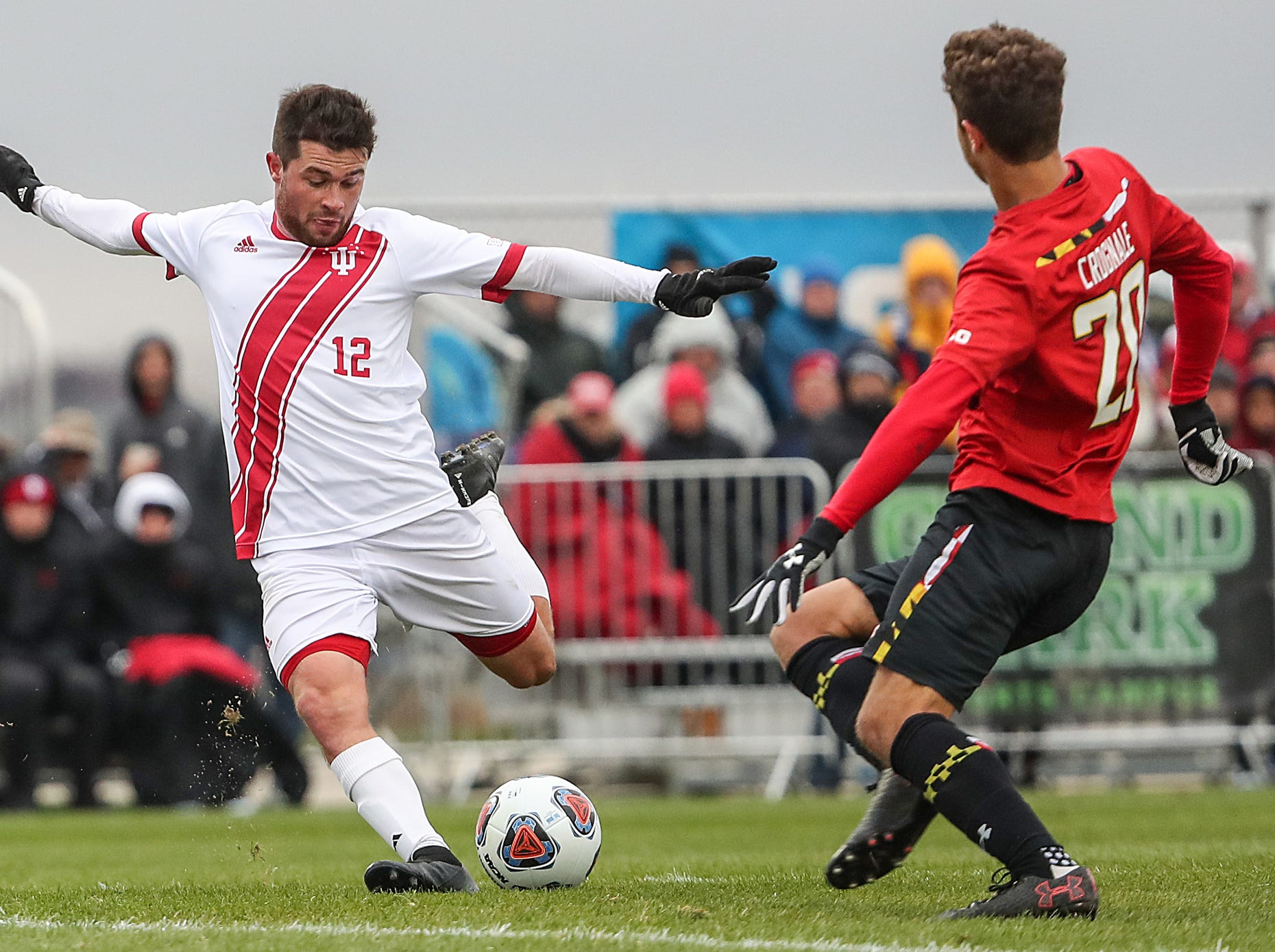 Maryland Terrapins midfielder Eli Crognale (20) defends as Indiana Hoosiers Austin Panchot (12) takes an successful shot during the first half of Big Ten semifinals at Grand Park in Westfield, Ind., Friday, Nov. 9, 2018. Indiana and Maryland tied 1-1, with the Hoosiers advancing in penalty kicks, 4-3.