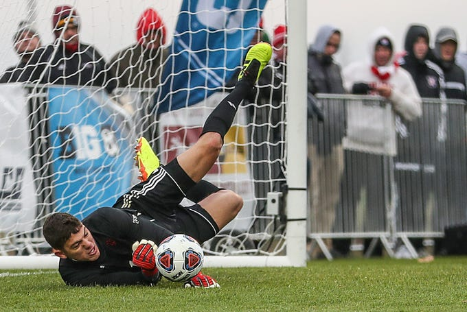 Indiana Hoosiers Trey Muse (1) blocks a penalty kick by Maryland near the end of Big Ten semifinals at Grand Park in Westfield, Ind., Friday, Nov. 9, 2018. Indiana and Maryland tied 1-1, with the Hoosiers advancing in penalty kicks, 4-3.